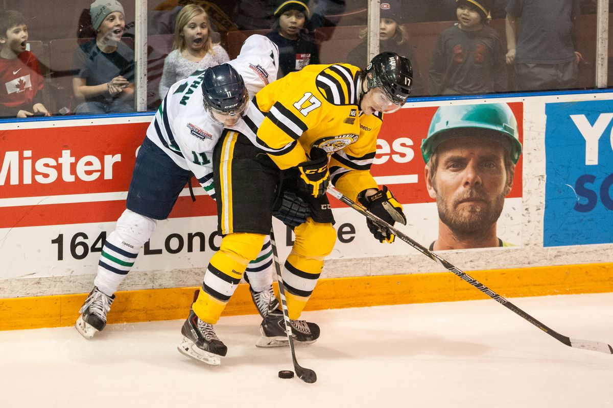 Connor Chatham, seen above in white, battling for a puck in a game last year against Sarnia, has 2 goals and 3 assists over his last 4 games.