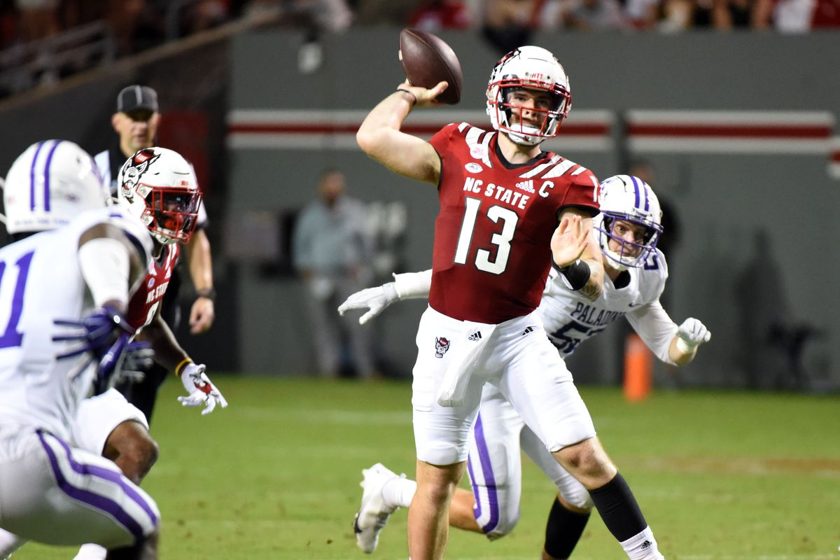 North Carolina State Wolfpack quarterback Devin Leary (13) throws a pass during the first half against the Furman Paladins at Carter-Finley Stadium.