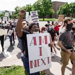 Charlen McNeil joins others in protest in the wake of the death of George Floyd, who died in police custody in Minneapolis, in Salt Lake City on Saturday, May 30, 2020.