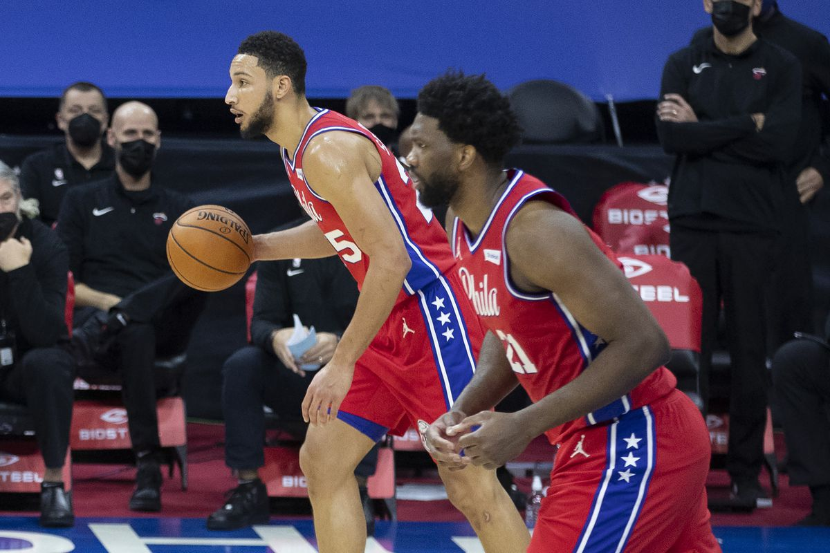 Ben Simmons of the Philadelphia 76ers dribbles the ball as Joel Embiid makes his way up the court against the Miami Heat at the Wells Fargo Center on January 14, 2021 in Philadelphia, Pennsylvania.