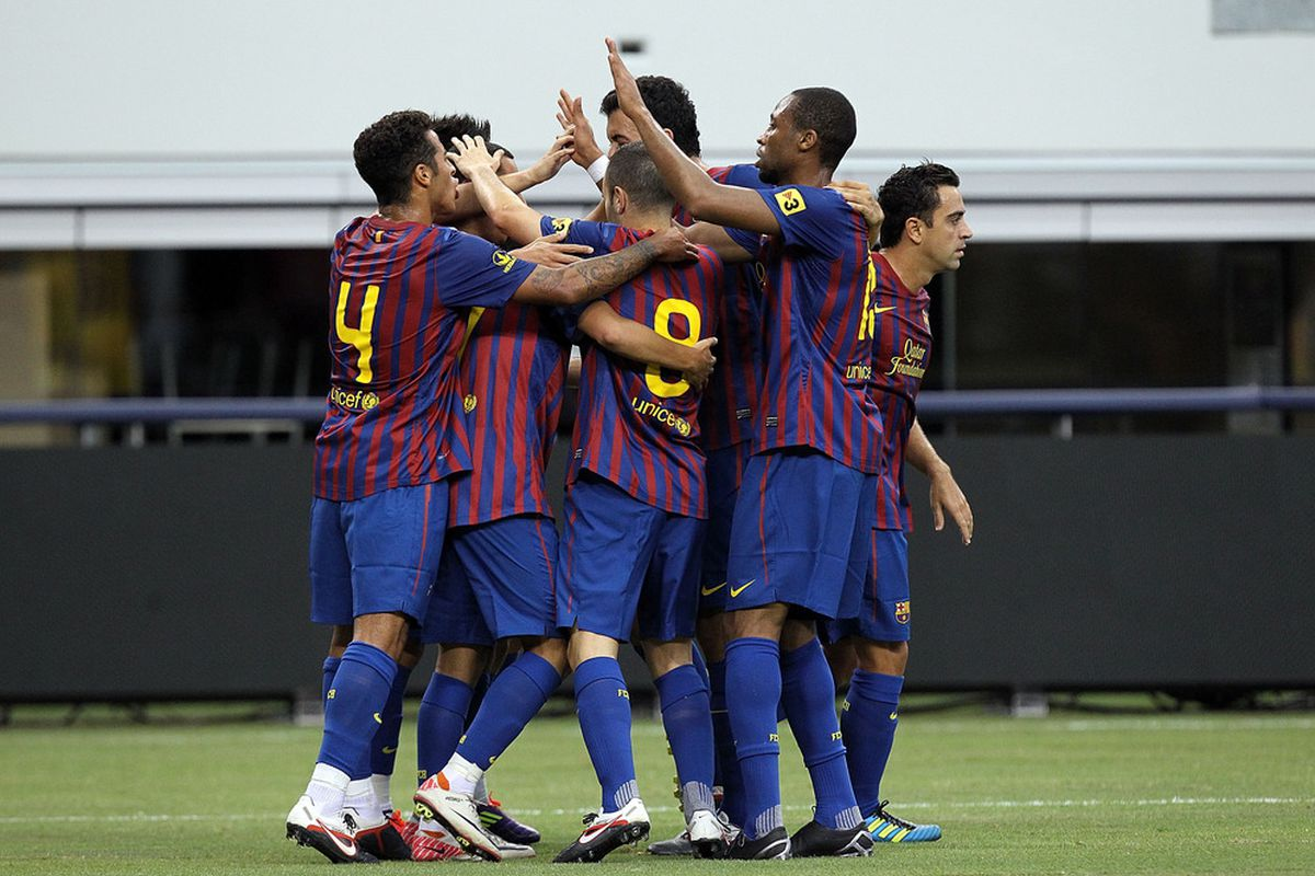 ARLINGTON, TX - AUGUST 06:  FC Barcelona celebrates a goal by David Villa #7 against Club America at Cowboys Stadium on August 6, 2011 in Arlington, Texas.  (Photo by Ronald Martinez/Getty Images)