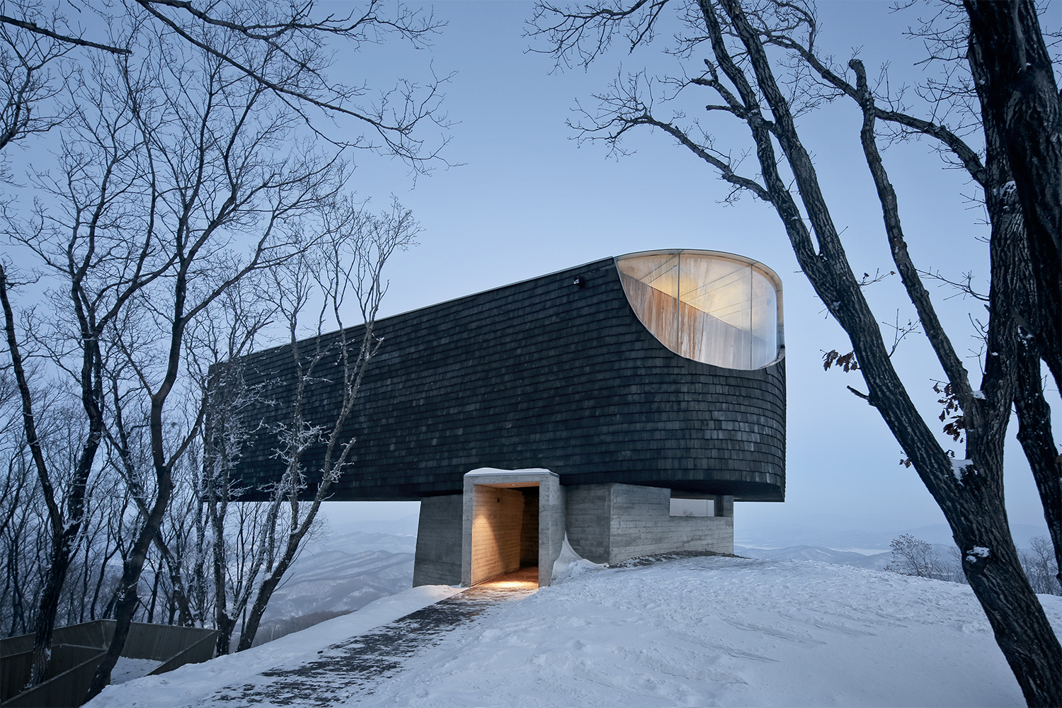 Cantilevered concrete and wood lookout frames astounding views