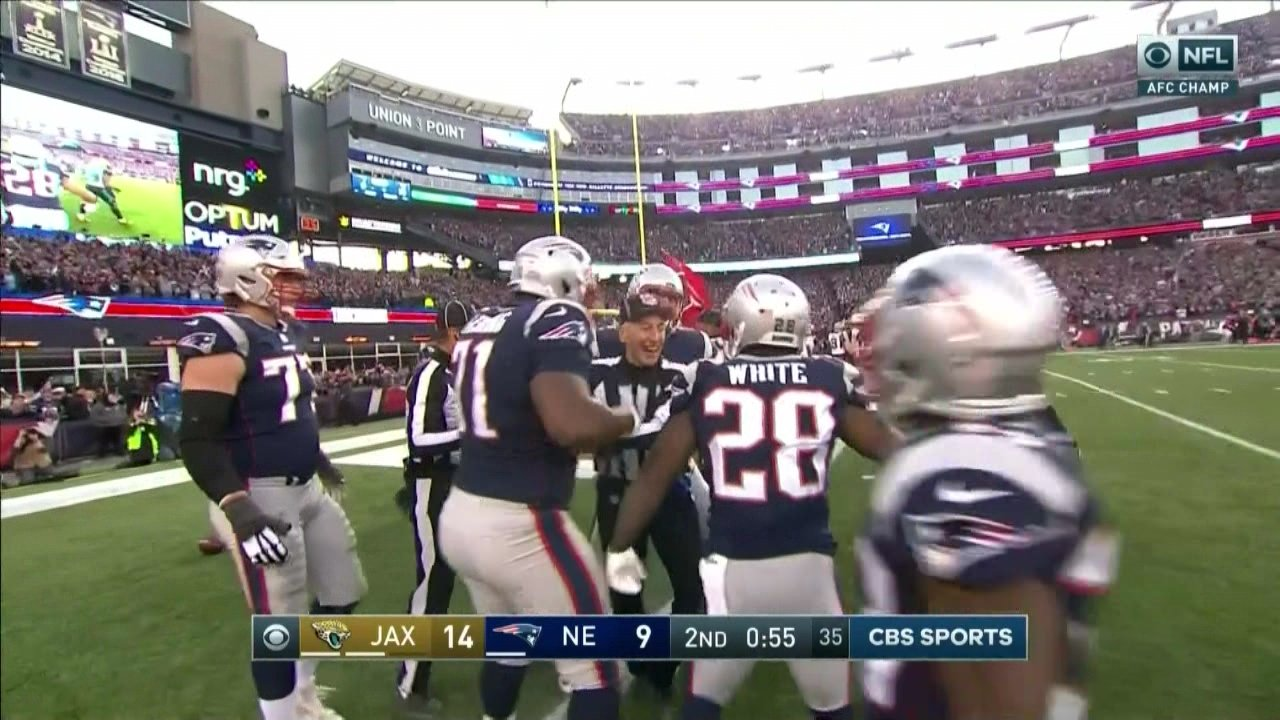 This referee was smiling really big with the Patriots after their touchdown