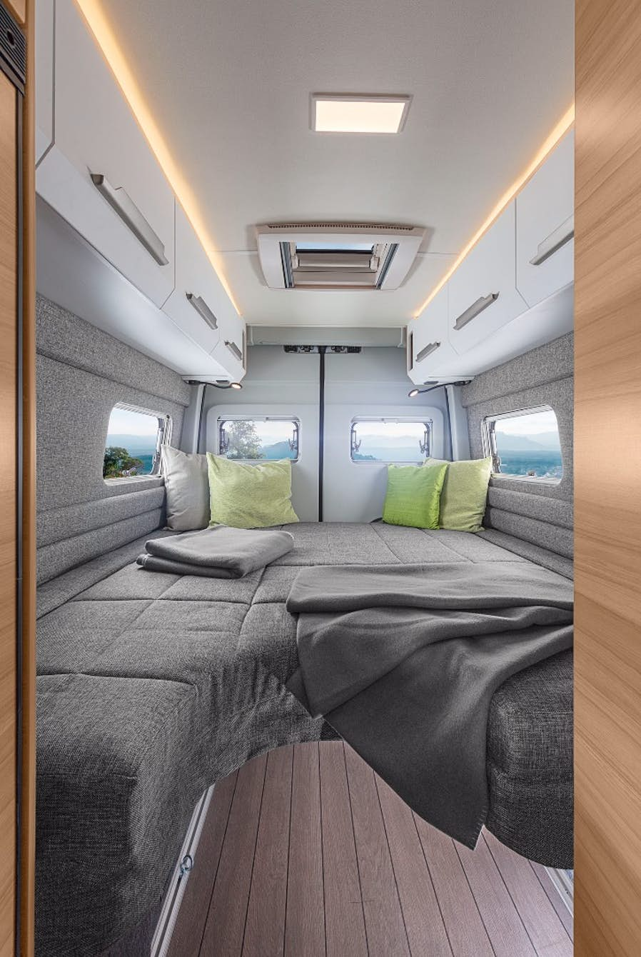 Knaus Boxdrive Camper Uses Folding Bed And Wet Bath To