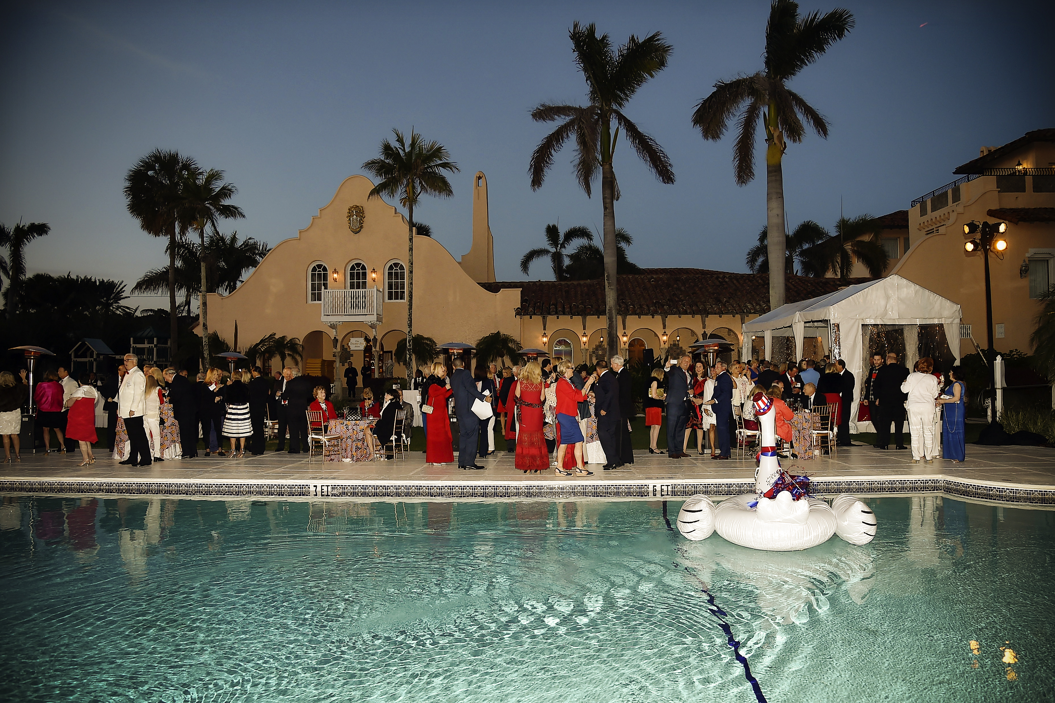 Guests around the pool at President Trump's one year anniversary with over 800 guests at the winter White House at Mar-a-Lago on January 18, 2018 in Palm Beach, Florida.  (Photo by Patrick McMullan/Patrick McMullan via Getty Images)
