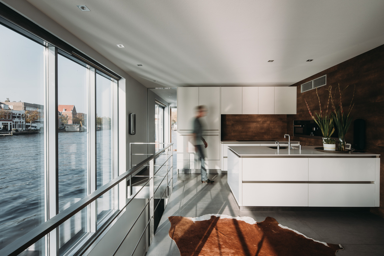 Solar-powered floating villa creates modern retreat in historic area
