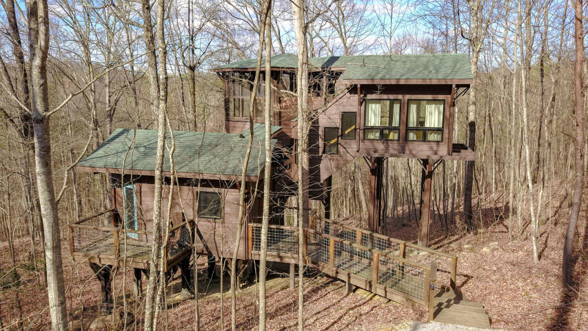 Nab this modern treehouse on 6 acres for $240K