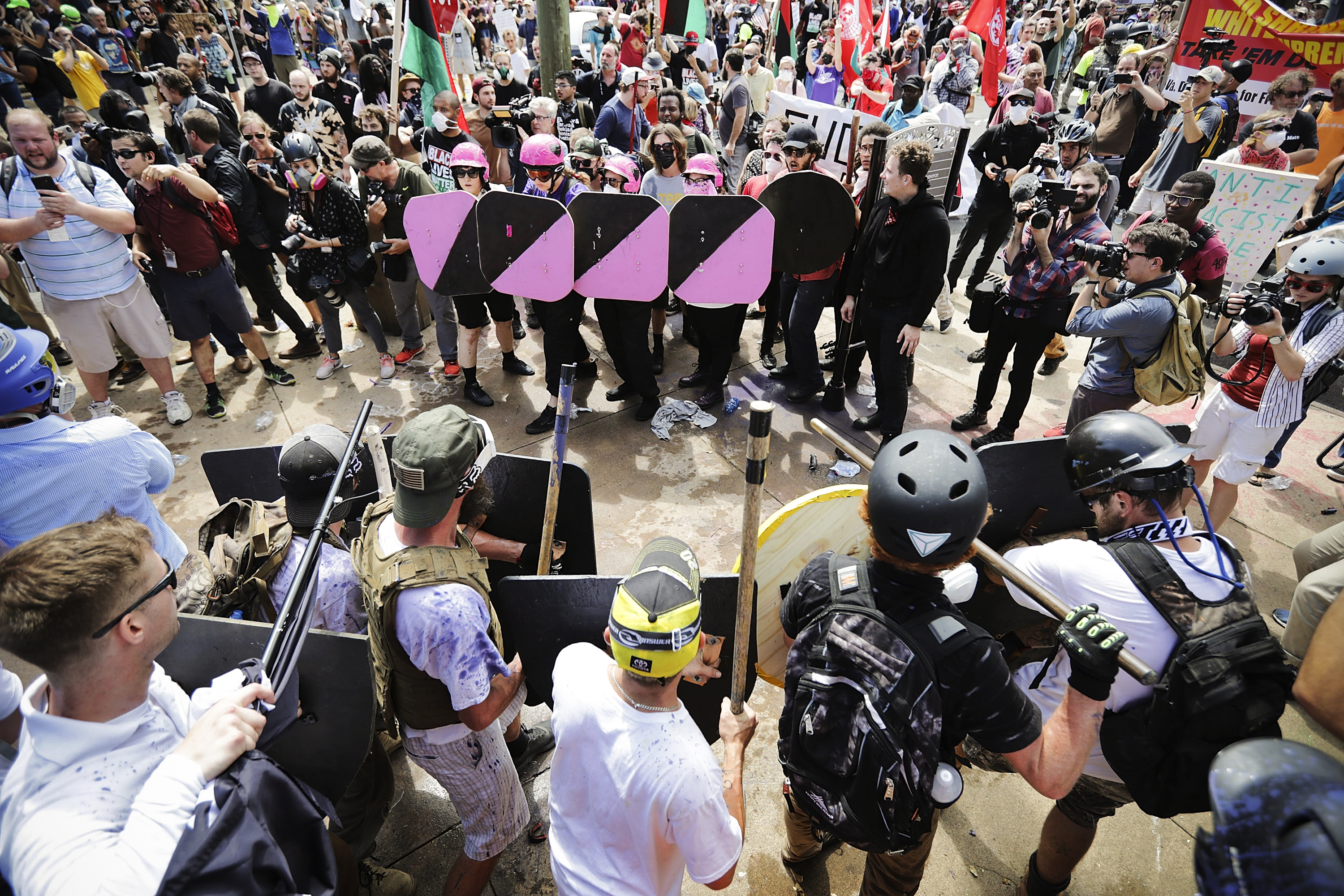 """Battle lines form between white nationalists, neo-Nazis, members of the """"alt-right,"""" and anti-fascist counterprotesters during the """"Unite the Right"""" rally in Charlottesville, Virginia, on August 12, 2017."""