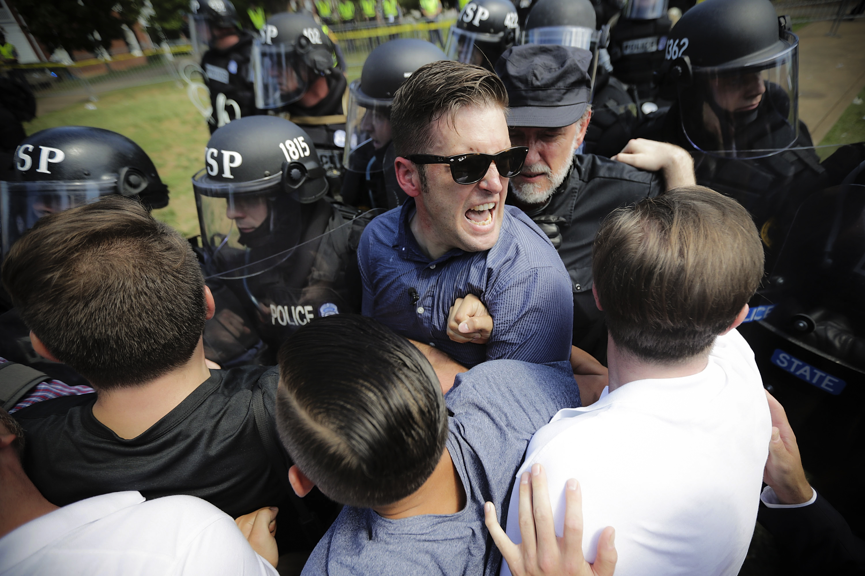 White nationalist Richard Spencer and his supporters clash with Virginia State Police in Emancipation Park after the