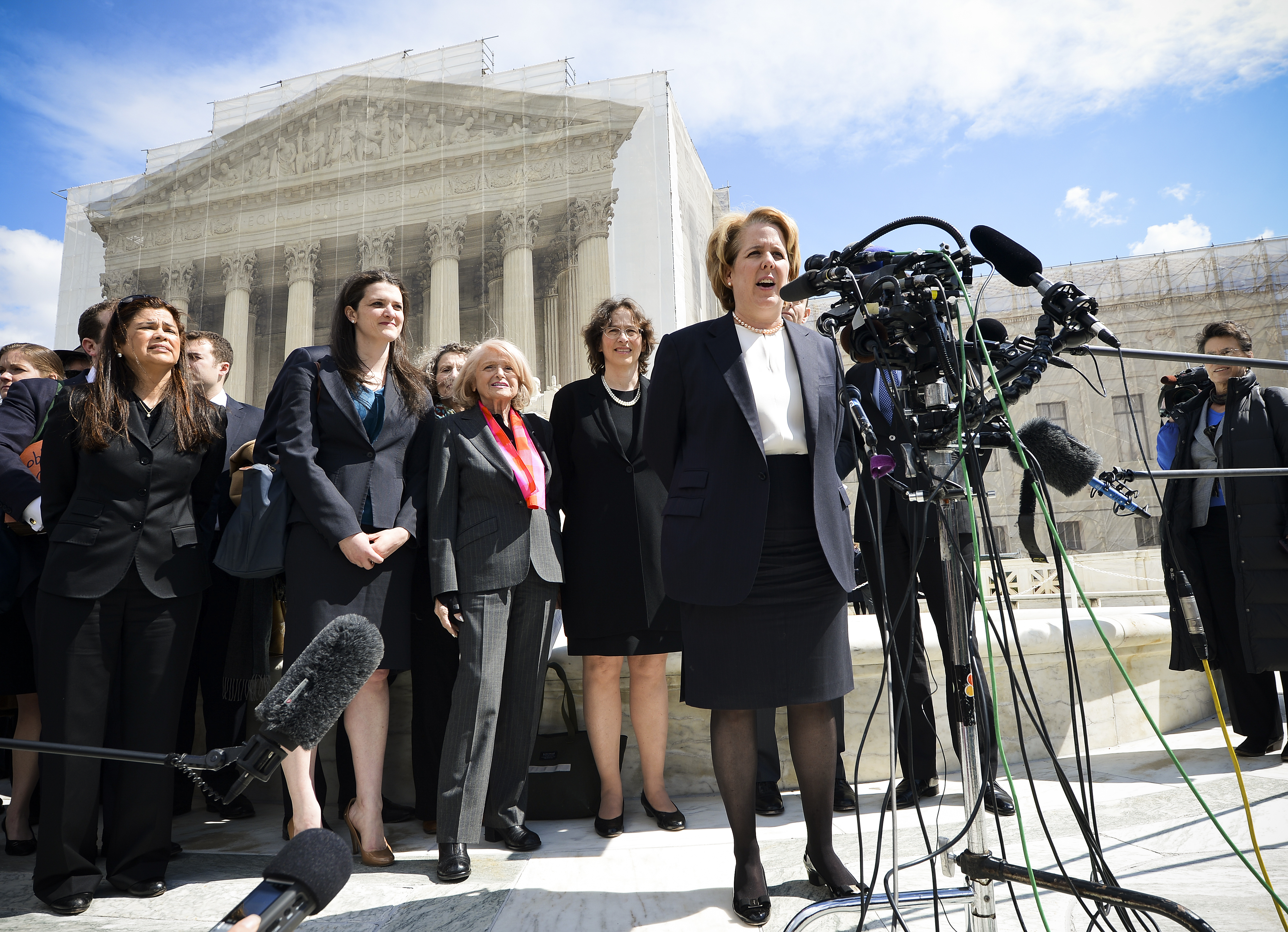 Roberta Kaplan is most famous for arguing the case  US v. Windsor before the Supreme Court in 2013. She represented Edie Windsor (center), an 83-year-old gay widow, which resulted in a landmark decision invalidating Section 3 of the Defense of Marriage Ac