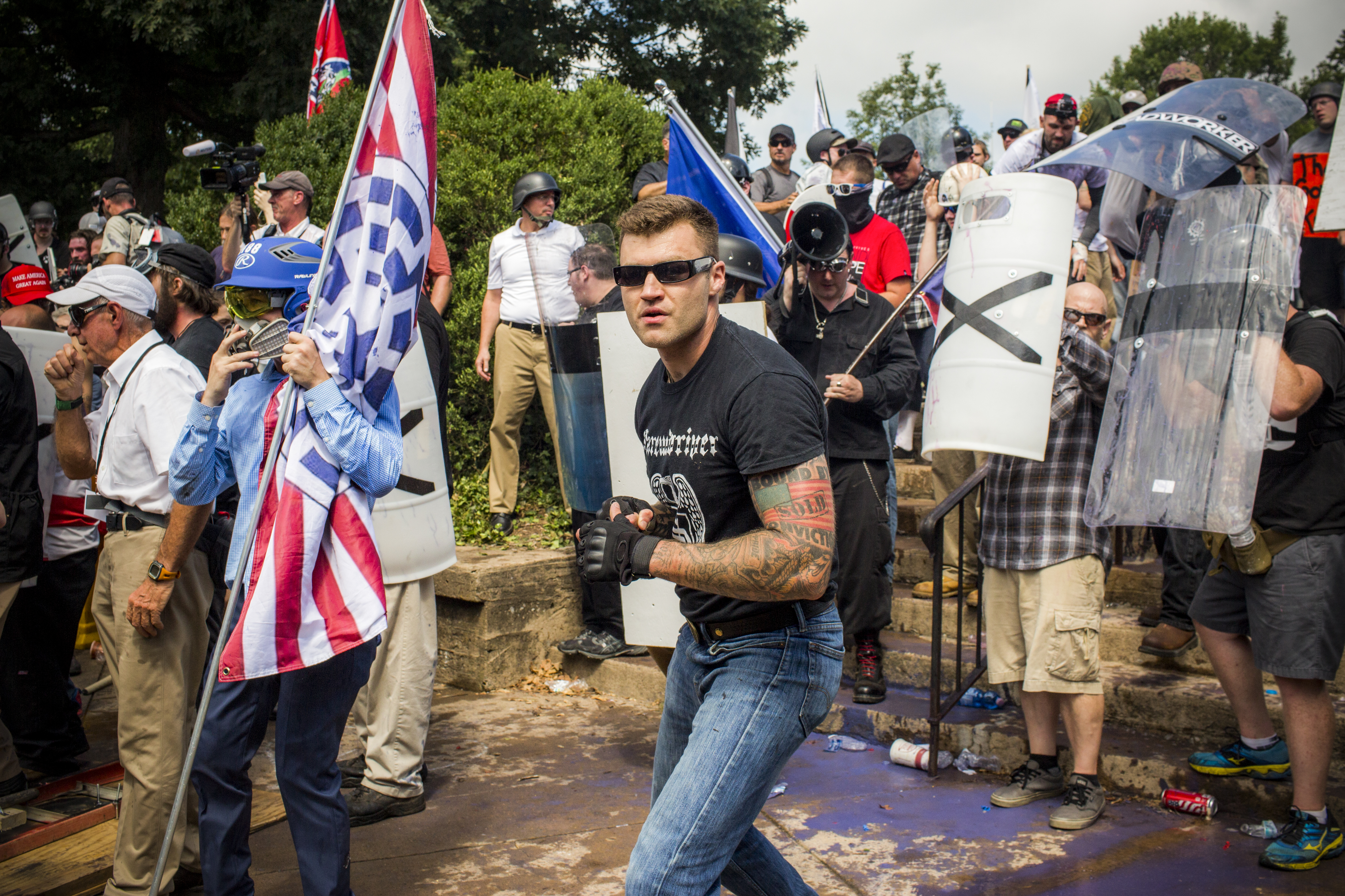 """White nationalists stand ready to fight ANTIFA and other protestors at the steps of Emancipation park during the """"Unite the Right Rally"""" in Charlottesville, Virginia, on August 12, 2017."""