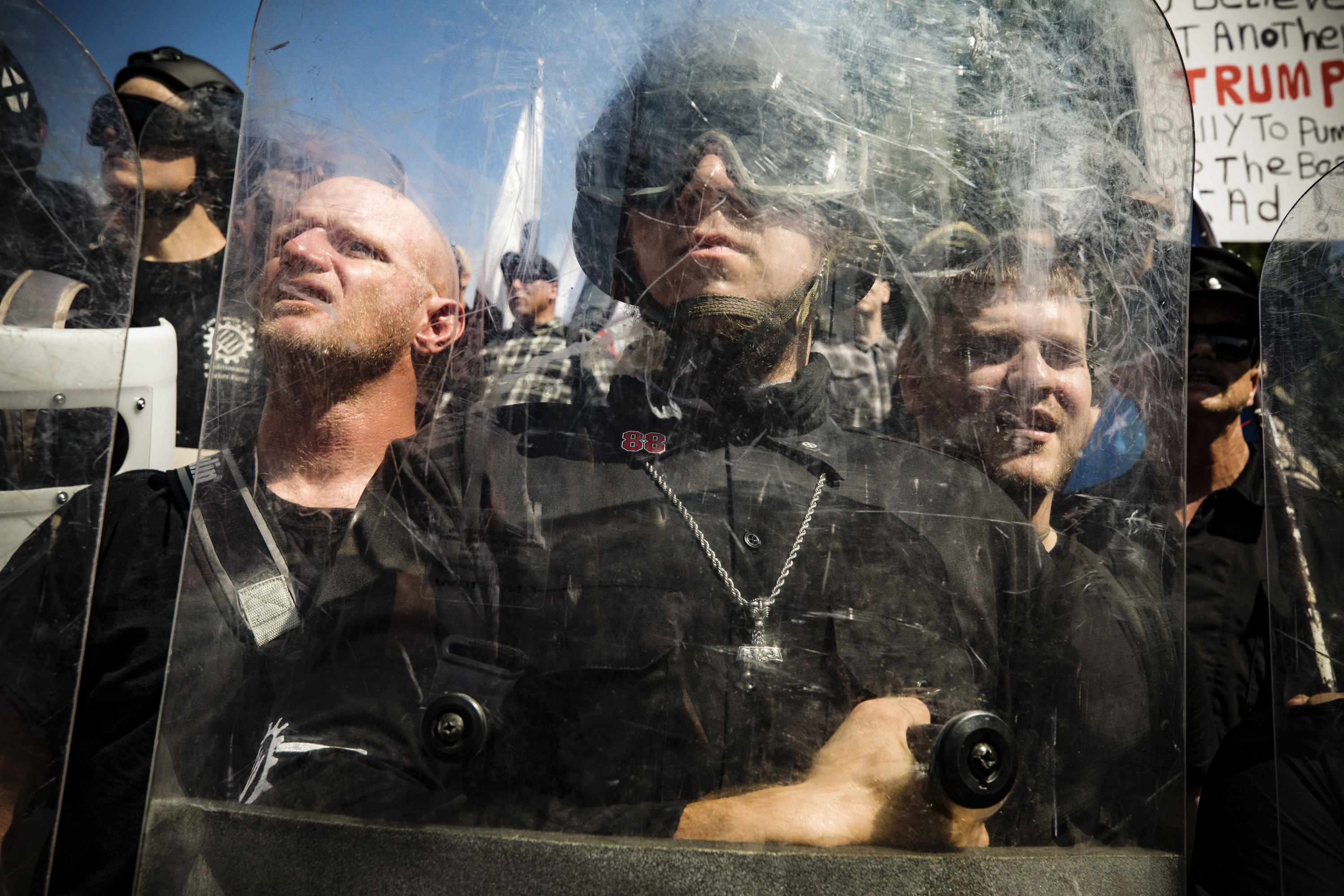 """White supremacists behind shields during the """"Unite the Right"""" rally in Charlottesville, Virginia, on August 12, 2017."""