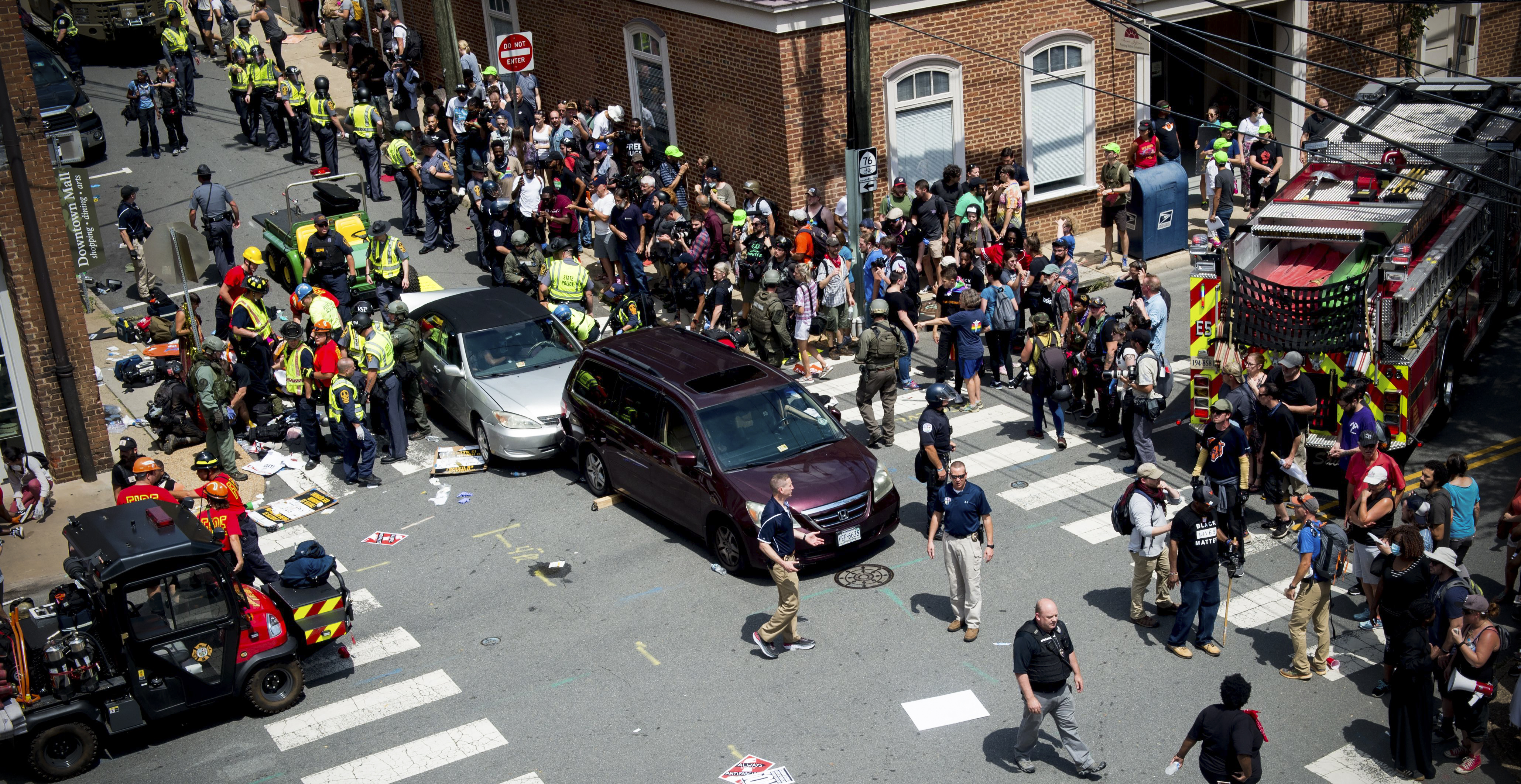 People receive first aid after a car ran into a crowd of protesters in Charlottesville, Virginia, on August 12, 2017.