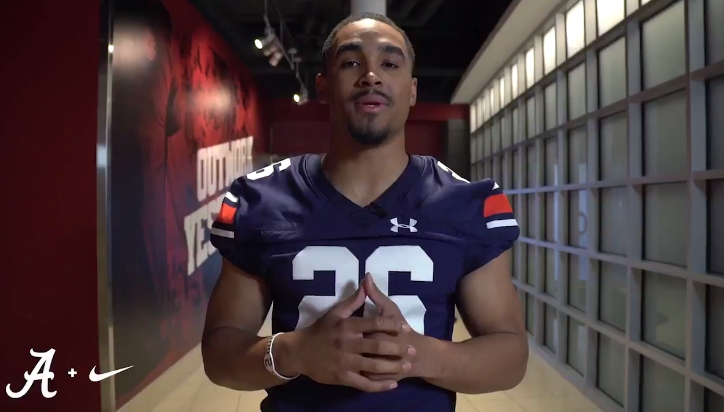 Alabama QB Jalen Hurts pays off bet, wears Auburn jersey