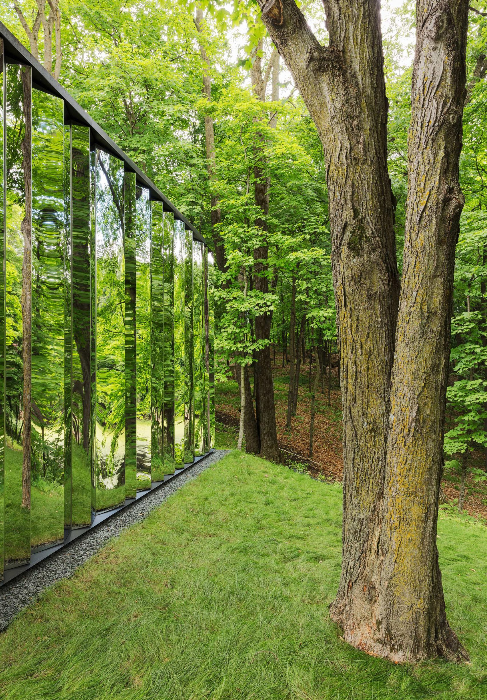 """Faceted """"shiny shed"""" completes glasshouse in the woods of Minnesota"""