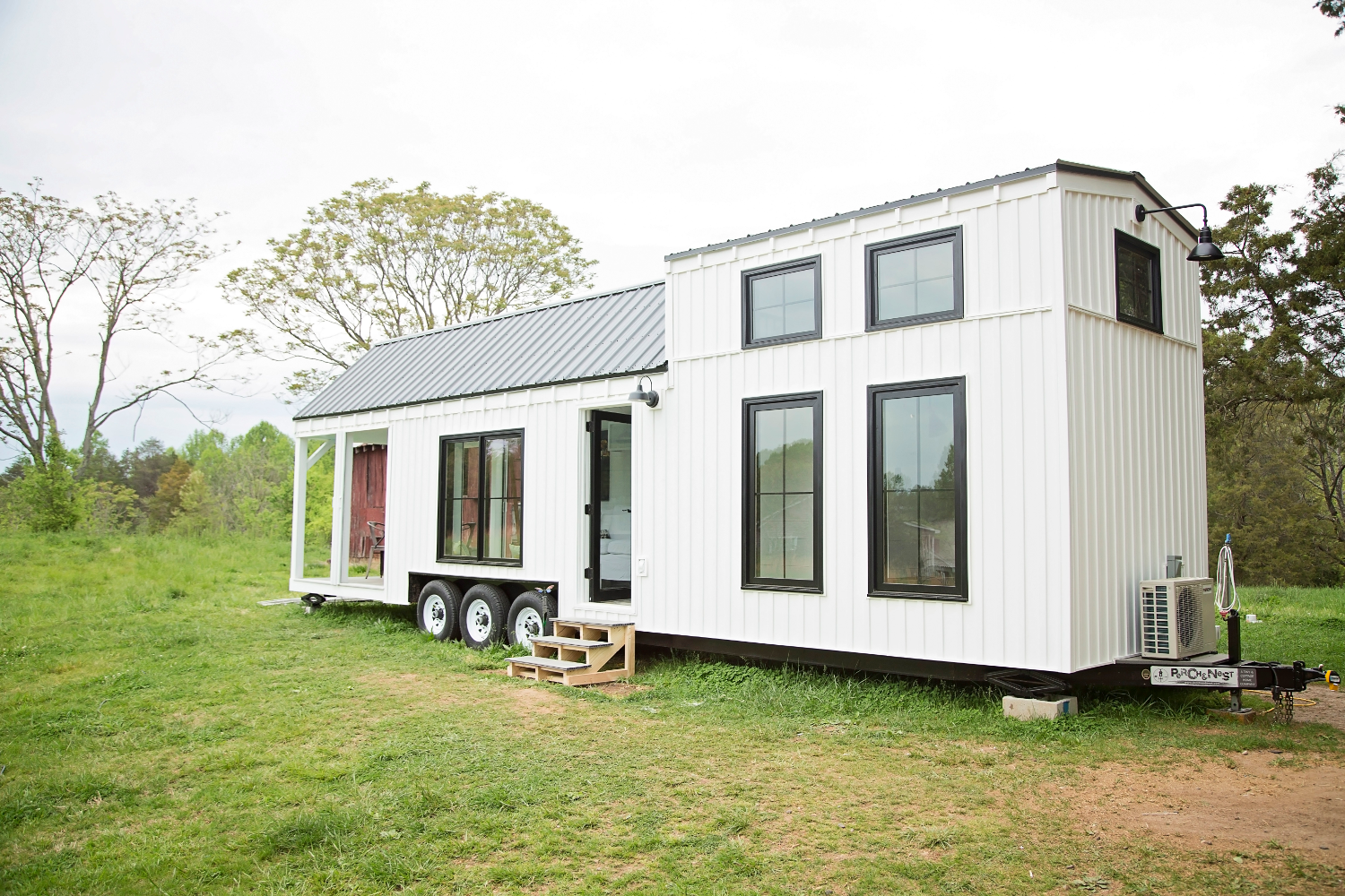 This farmhouse-style tiny house on wheels fits family of four
