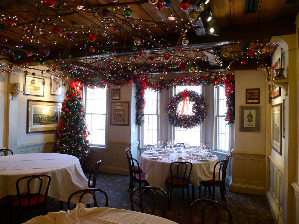 upstairs in 1789s middleburg room watts spent five hours stringing vines along the ceiling then hung white lights and hundreds of christmas ornaments