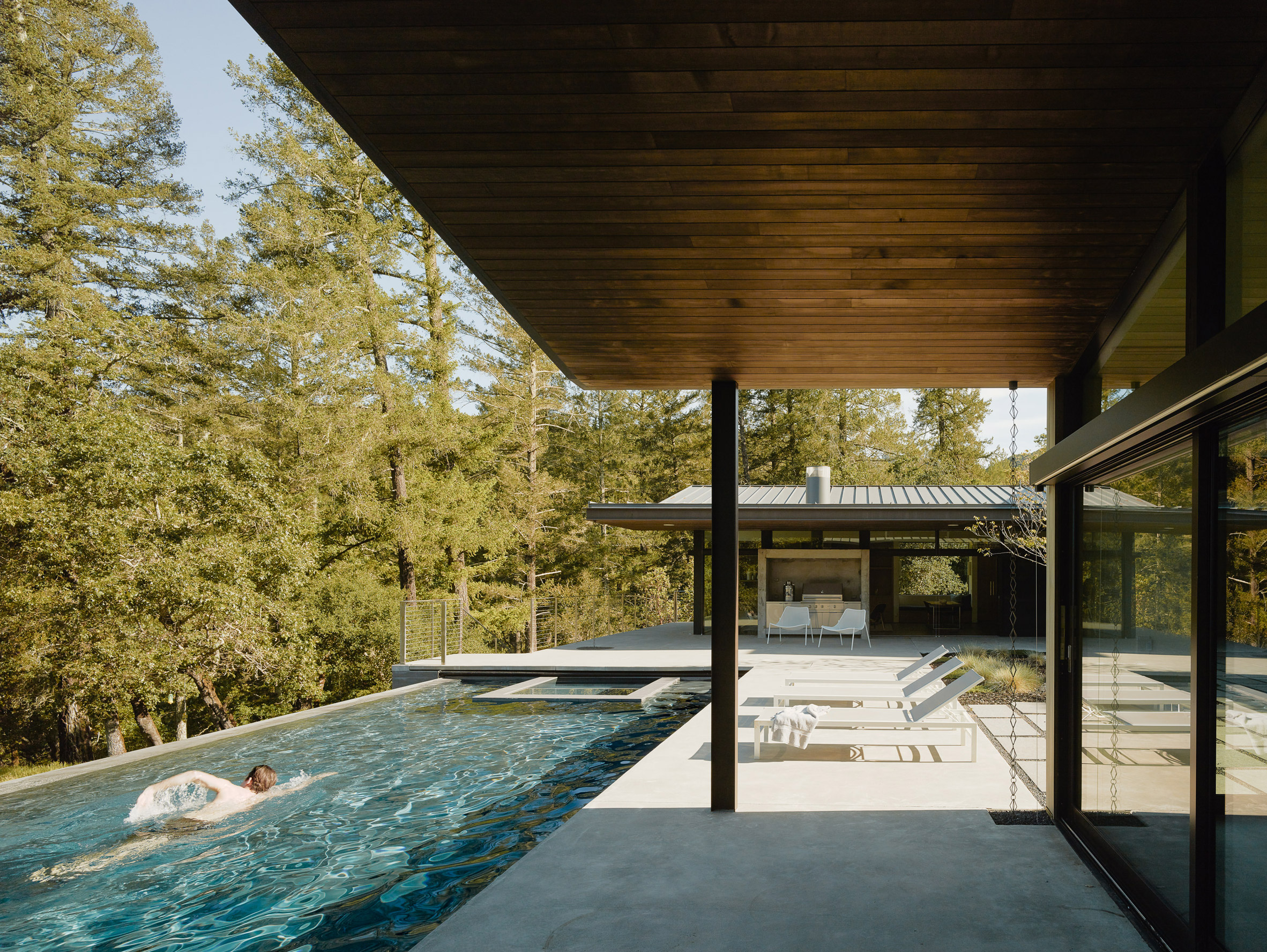Gorgeous modern home masterfully retreats into nature