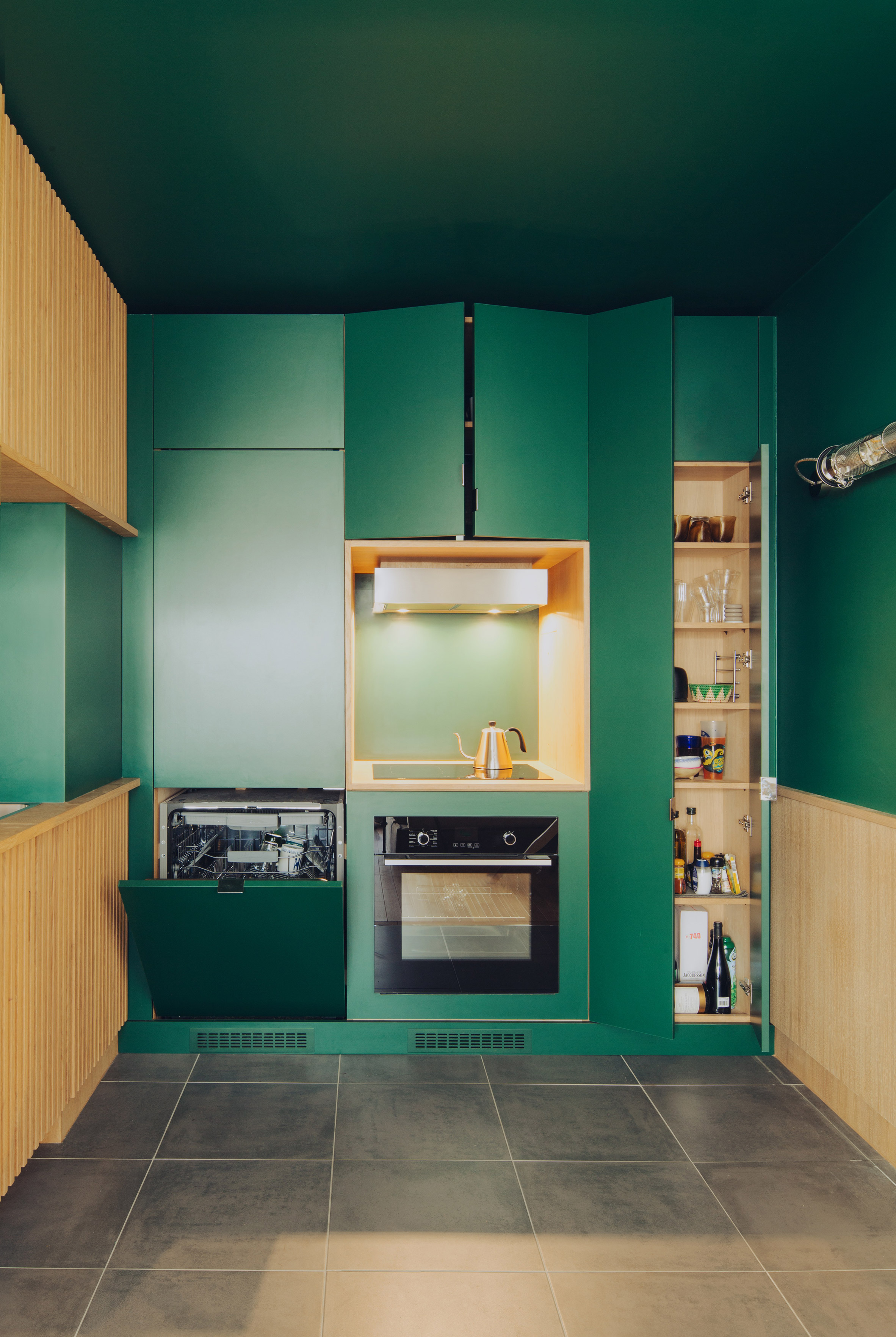Paris apartment goes bold with green kitchen