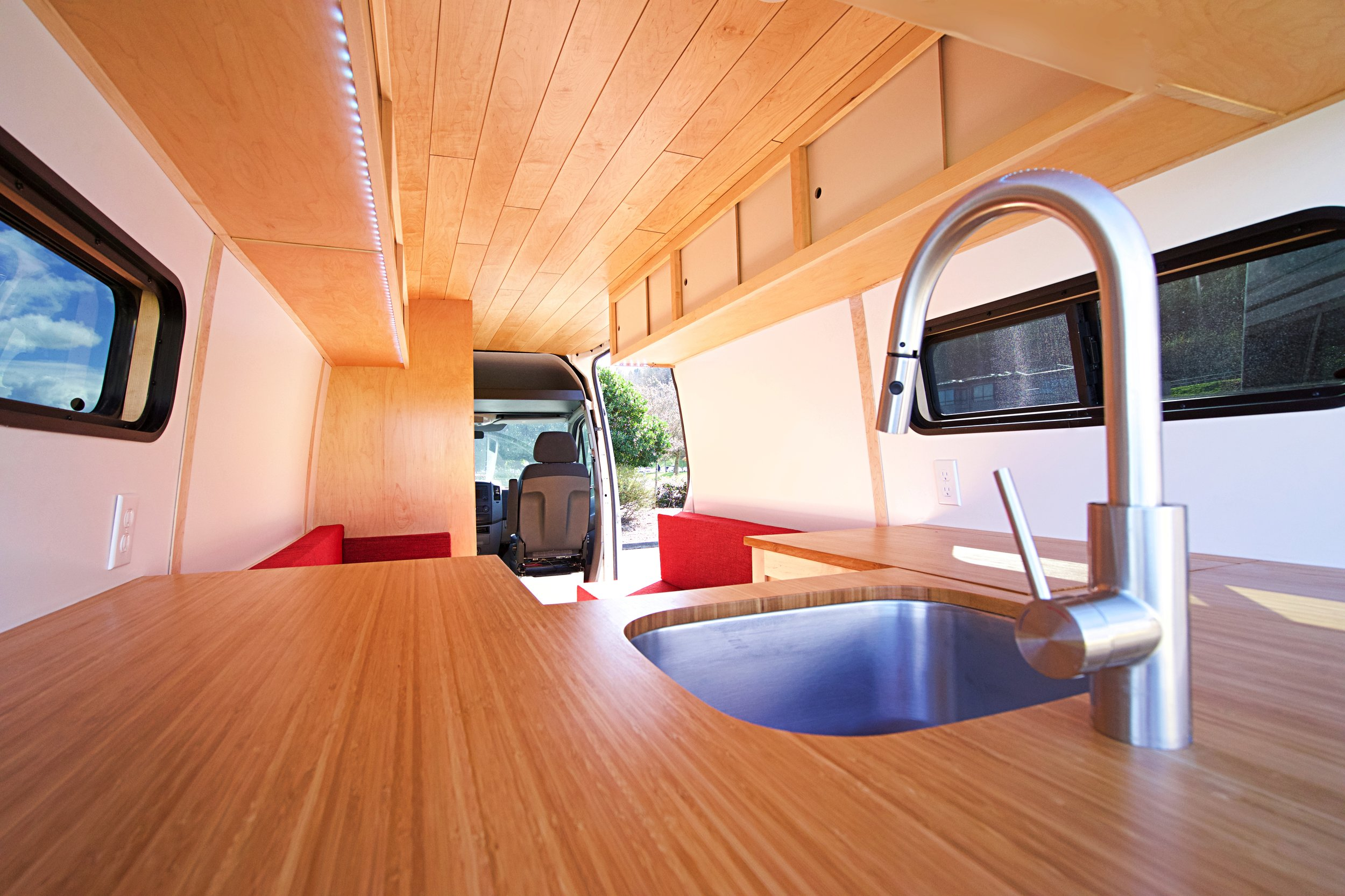 Cozy camper van stands out with custom woodworking