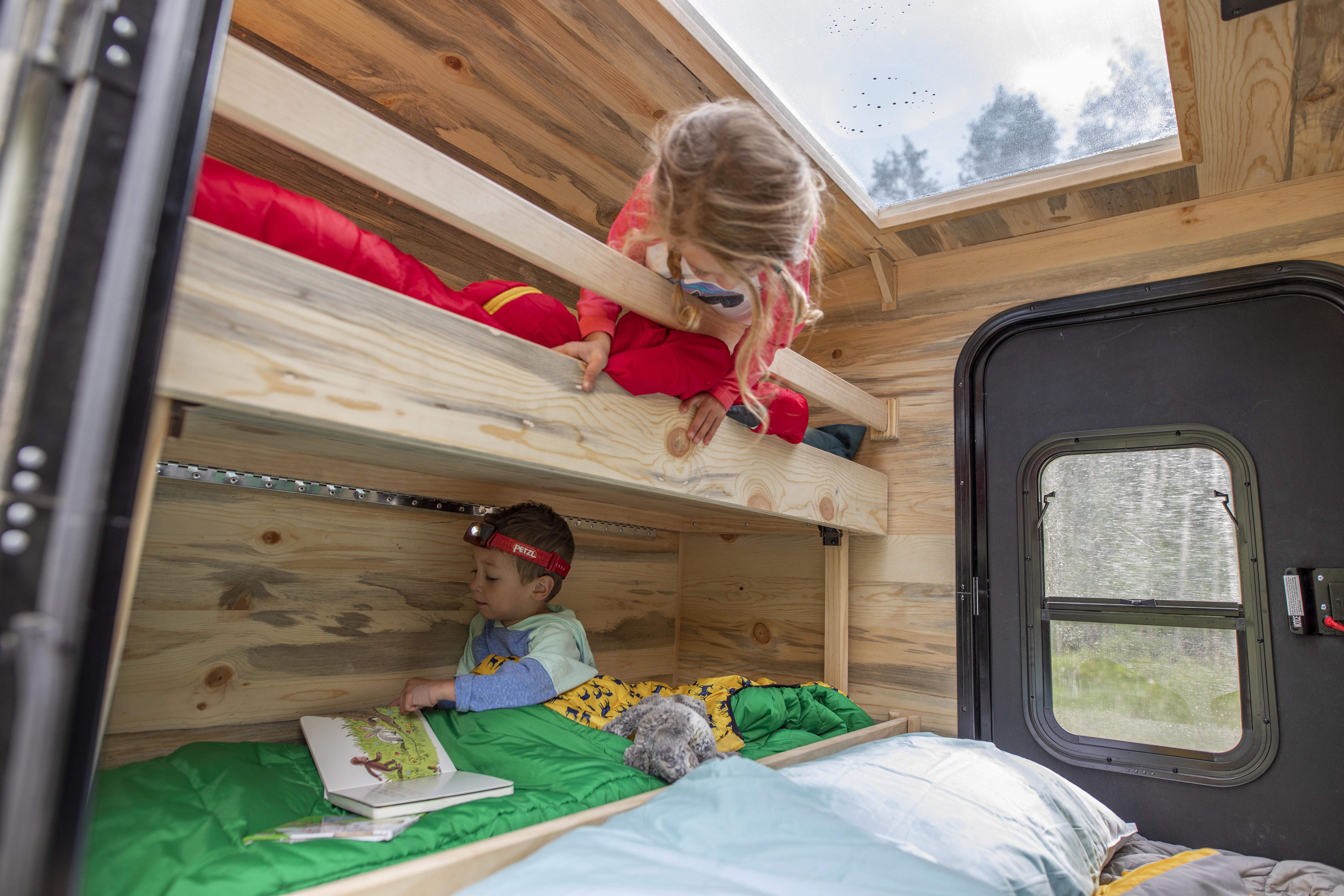 Teardrop trailer features bunkbeds to sleep a family of 4