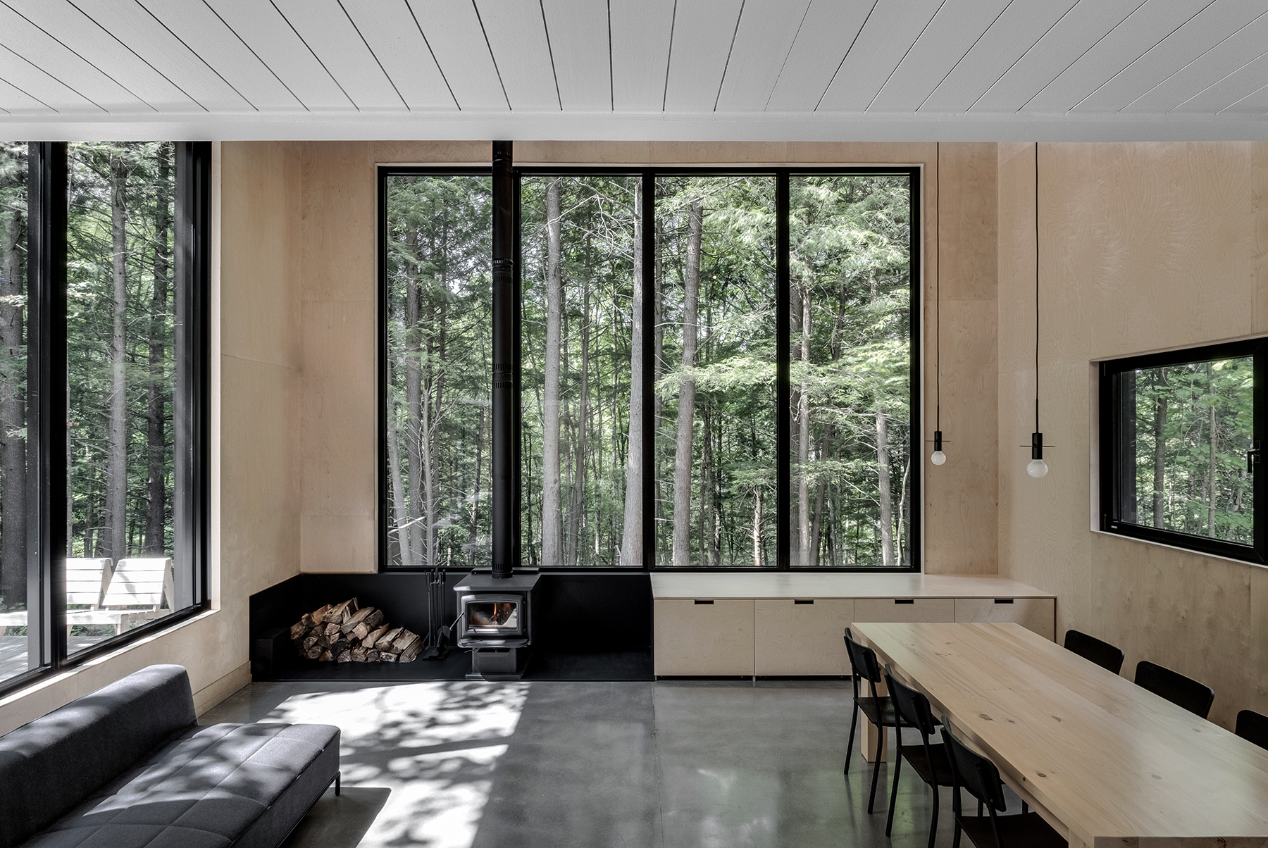 Chic black chalet does cabin in the woods right
