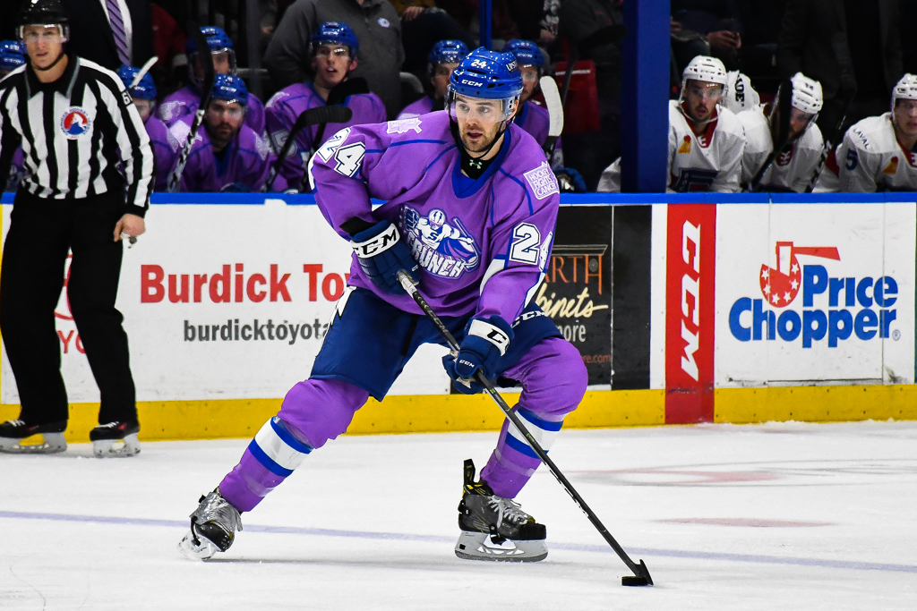 6f1fcdc54 Syracuse Crunch Cameron Gaunce (24) wearing the special Hockey Fights Cancer  jersey against the Laval Rocket in American Hockey League (AHL) action at  the ...