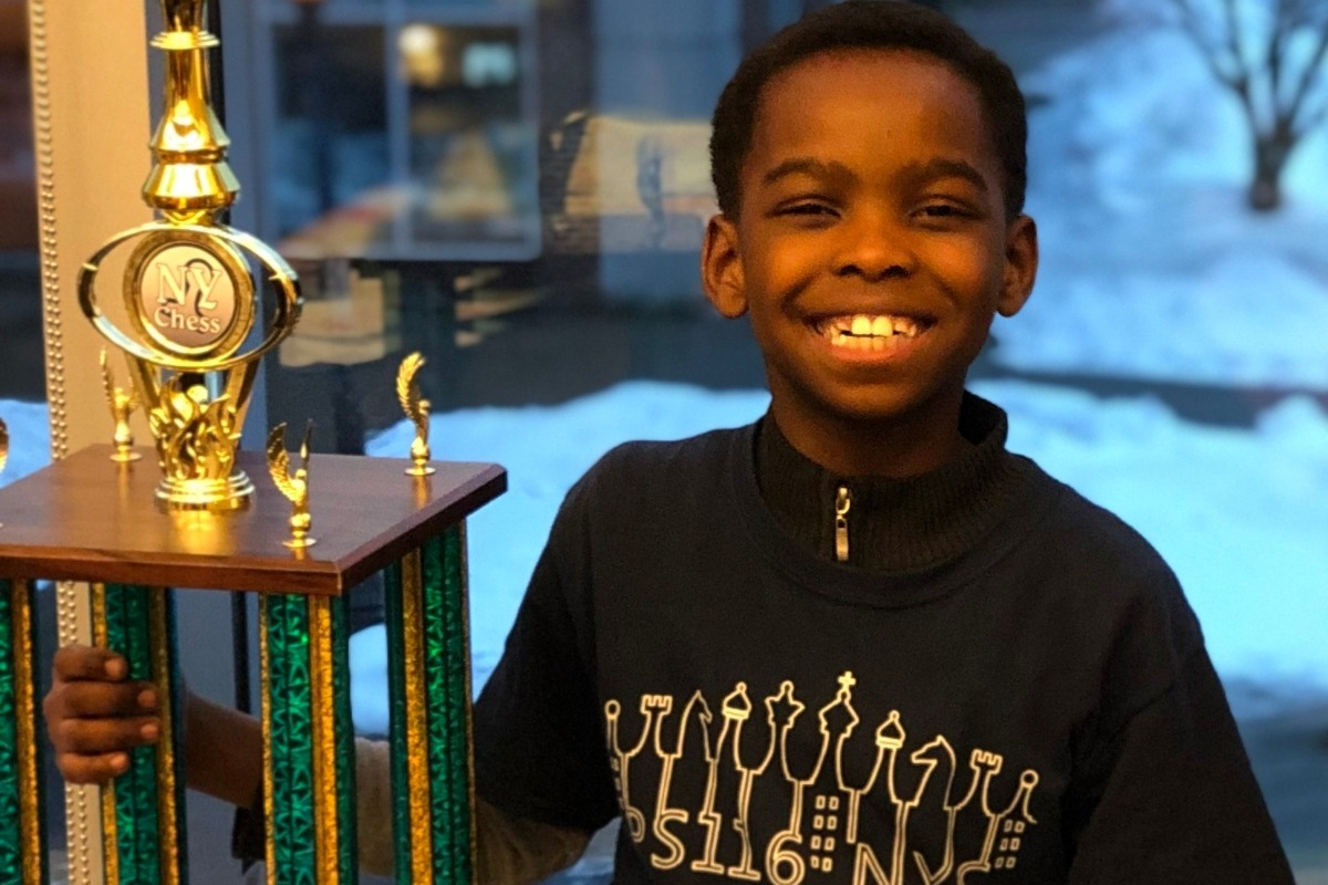 An 8-year-old homeless refugee schooled rich private school kids to win a New York chess championship
