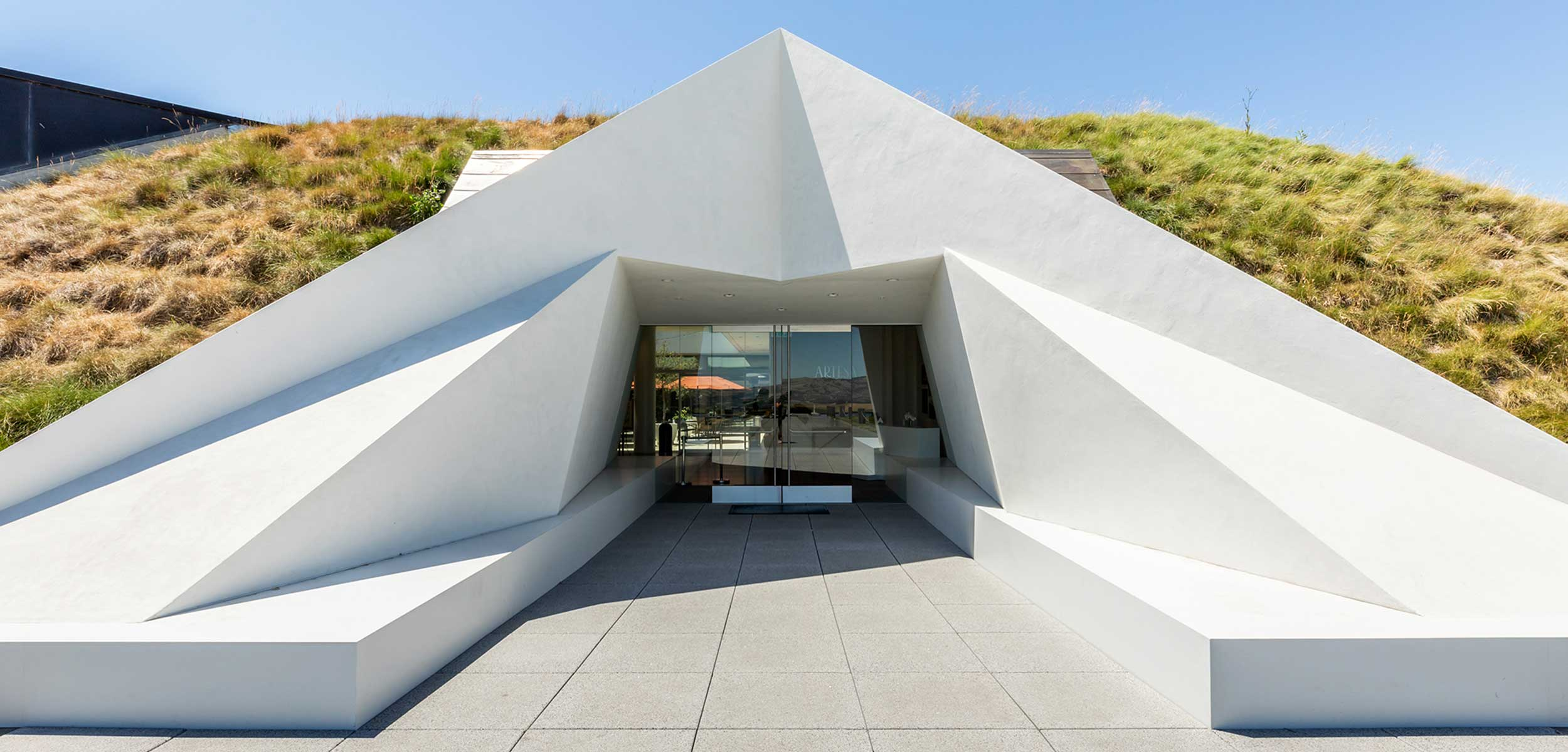 White geometric avant garde building at the entrance to Artesa Winery, Napa Valley.