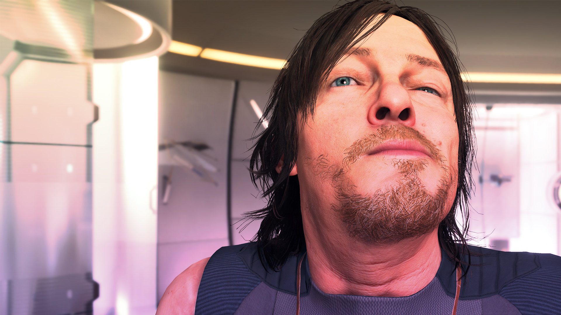 Death Stranding protagonist Sam makes a face in a mirror