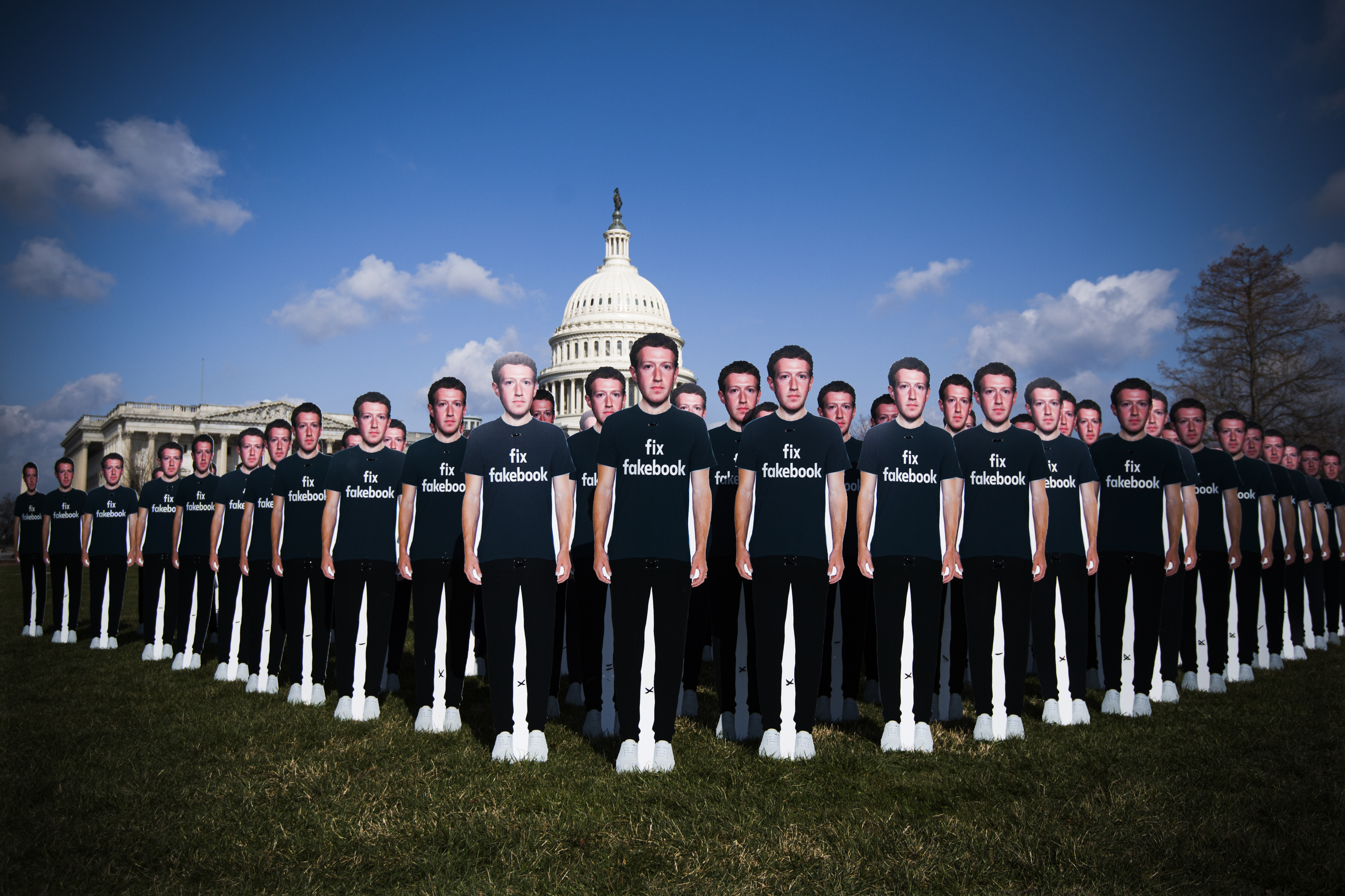 """Cutouts of Facebook CEO Mark Zuckerberg on the east lawn of the Capitol. His shirts all read, """"Fix Fakebook."""""""