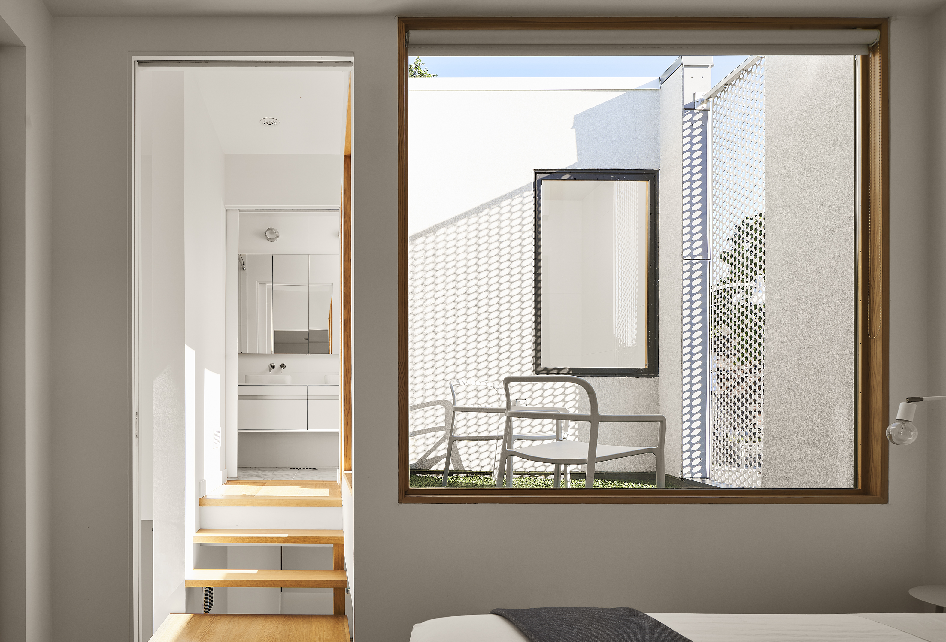 Two modern homes cleverly packed into one narrow lot