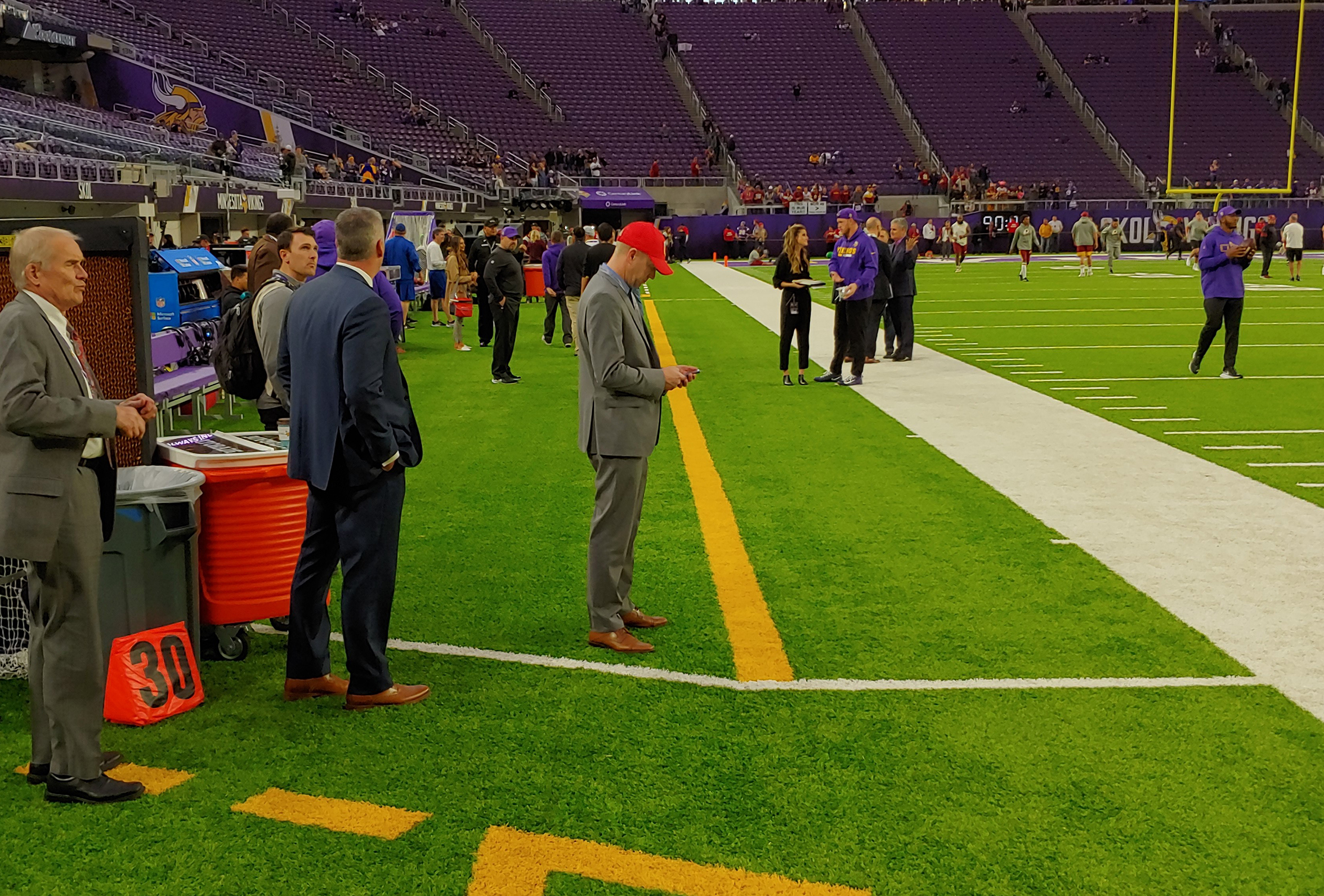 This pre-game photo shows the yellow stripes and dotted lines that help define the area that players and coaches are supposed to remain inside on the sidelines at U.S. Bank Stadium.
