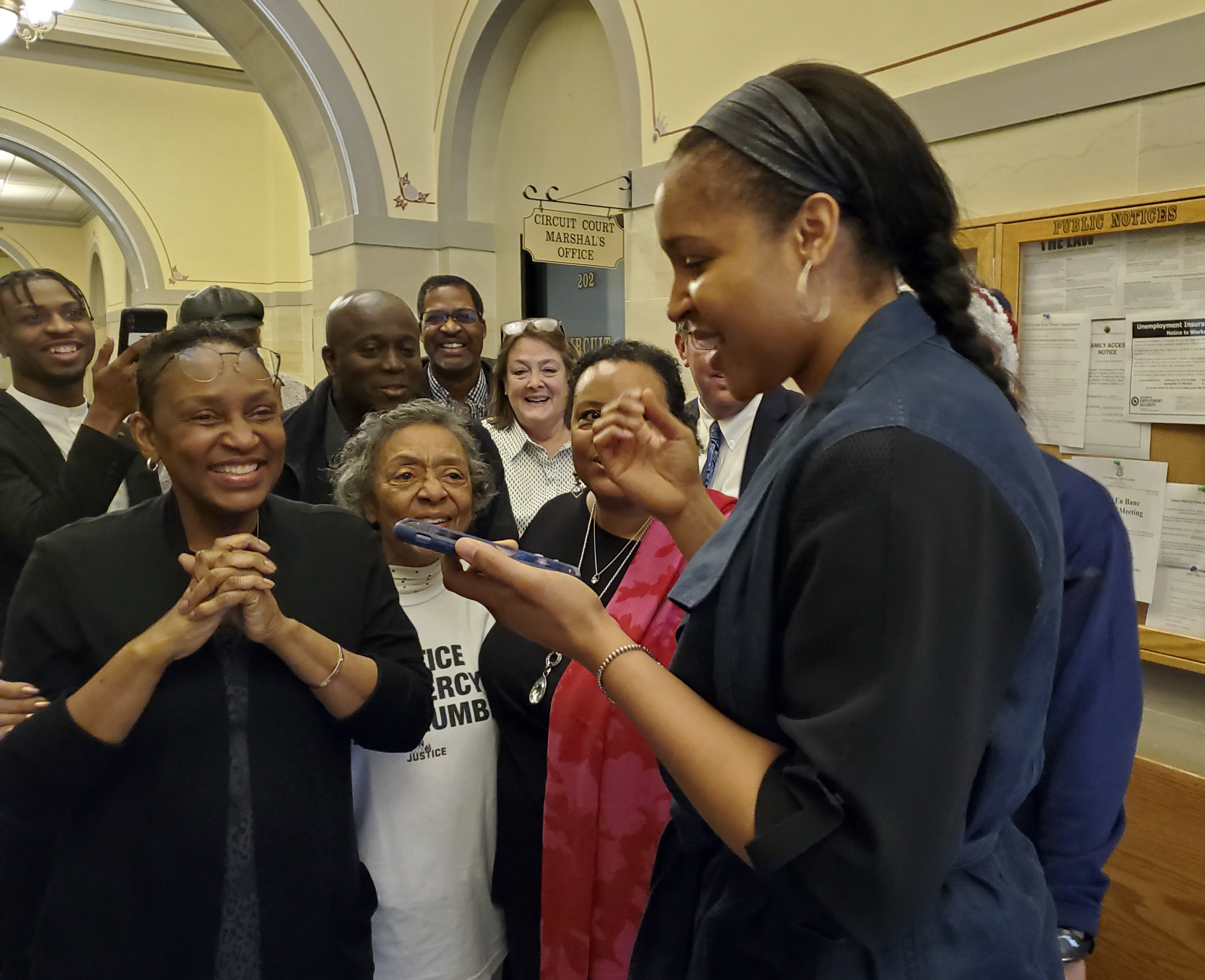Lynx star Maya Moore called Jonathan Irons on March 9 as supporters react in Jefferson City, Mo., after a judge overturned Irons' convictions in a 1997 burglary and assault case.