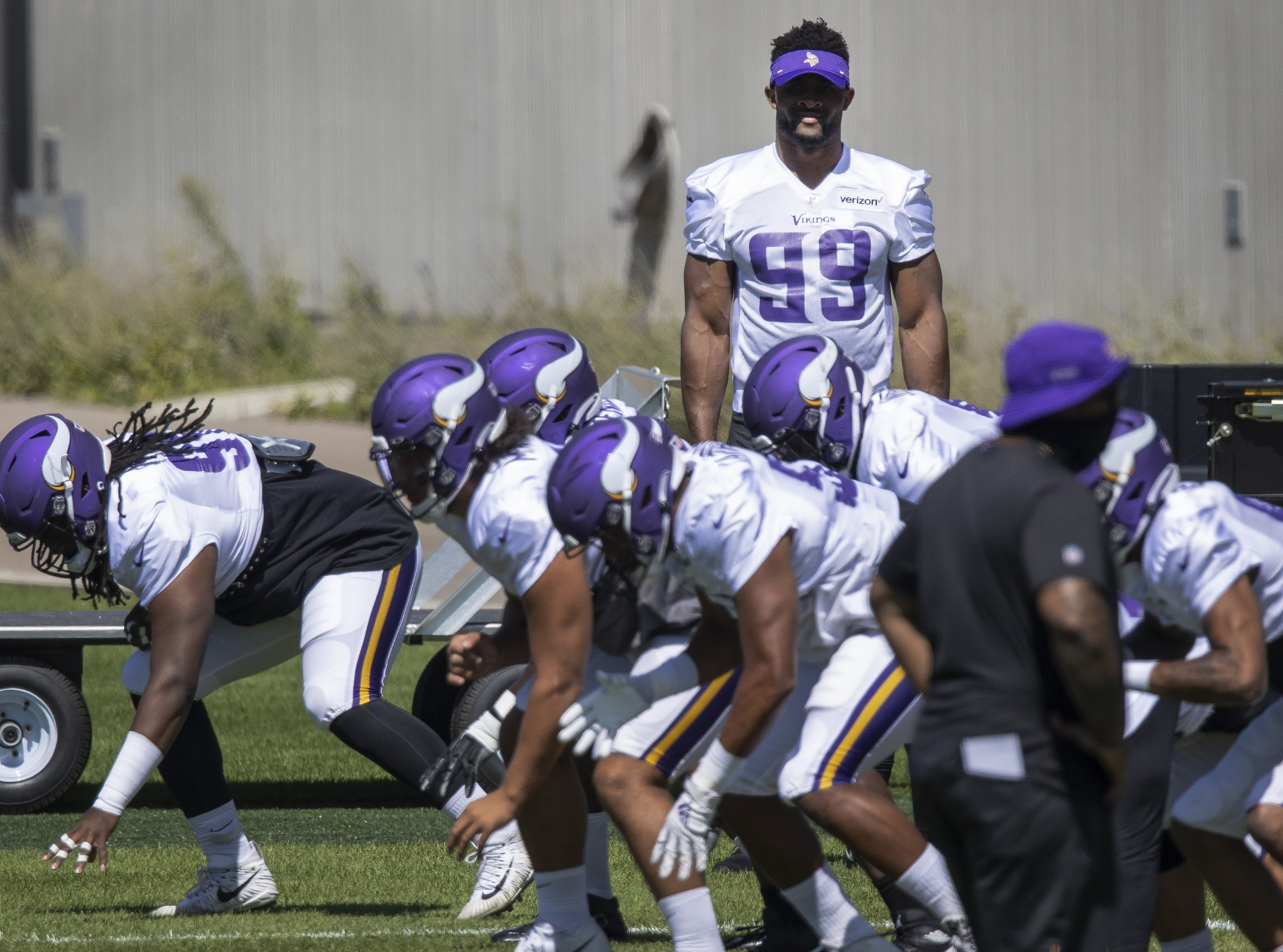 Danielle Hunter watching practice at training camp in August.