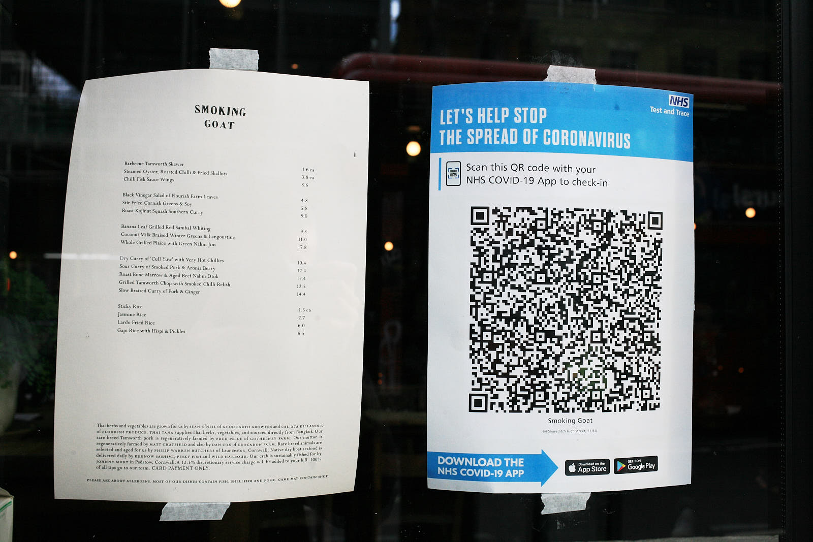Smoking Goat's menu and safety notice in the window of the restaurant —one of London's best Thai restaurants' safety precautions during the covid-19 pandemic