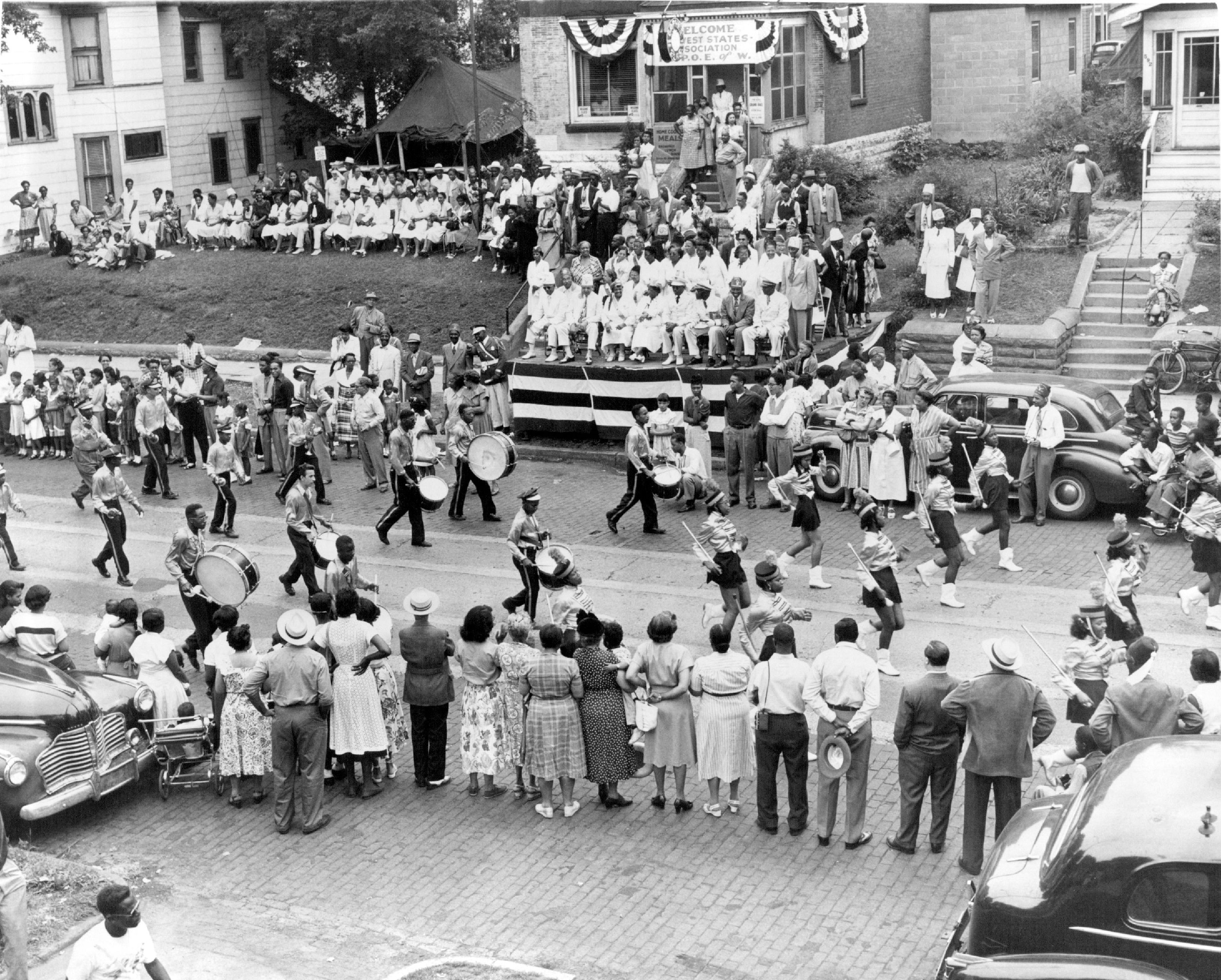 In July 1951, the Ralph Bates Marching Club from Omaha, Nebraska, passed the reviewing stand at 588 Rondo Ave. in St. Paul during a parade.