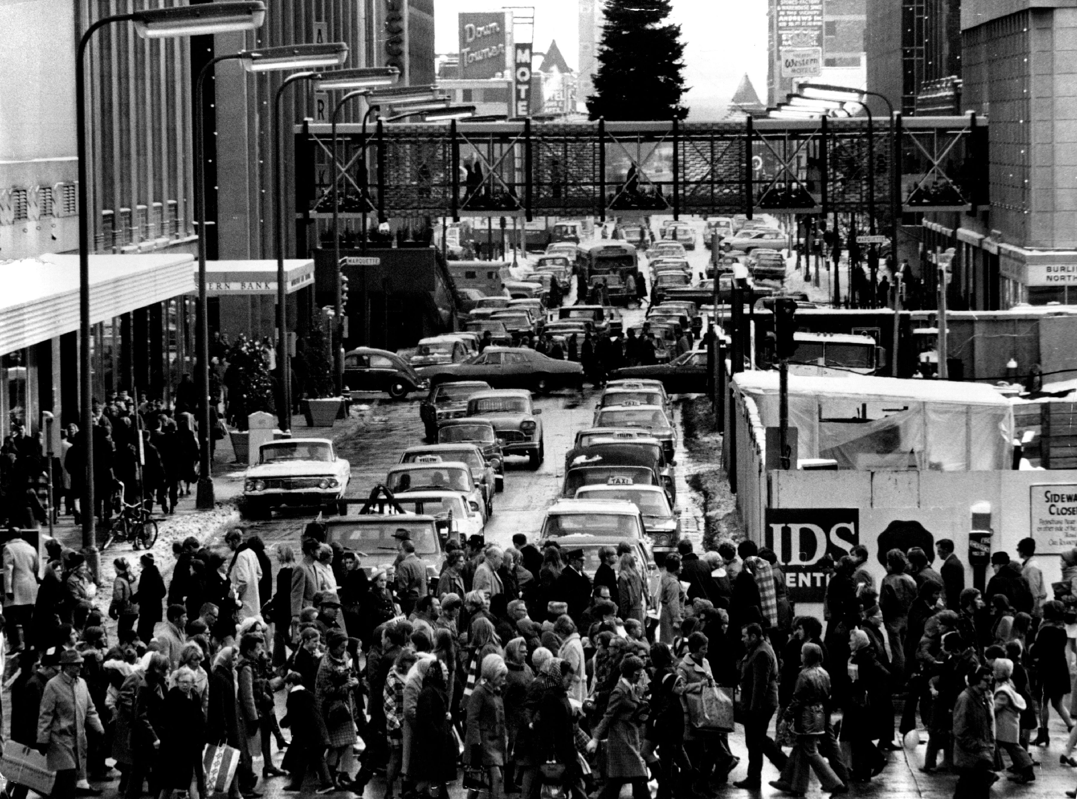 Nov. 28, 1970: Shoppers on foot and in cars crowded downtown Minneapolis the day after Thanksgiving for the traditional start of the Christmas shopping season.