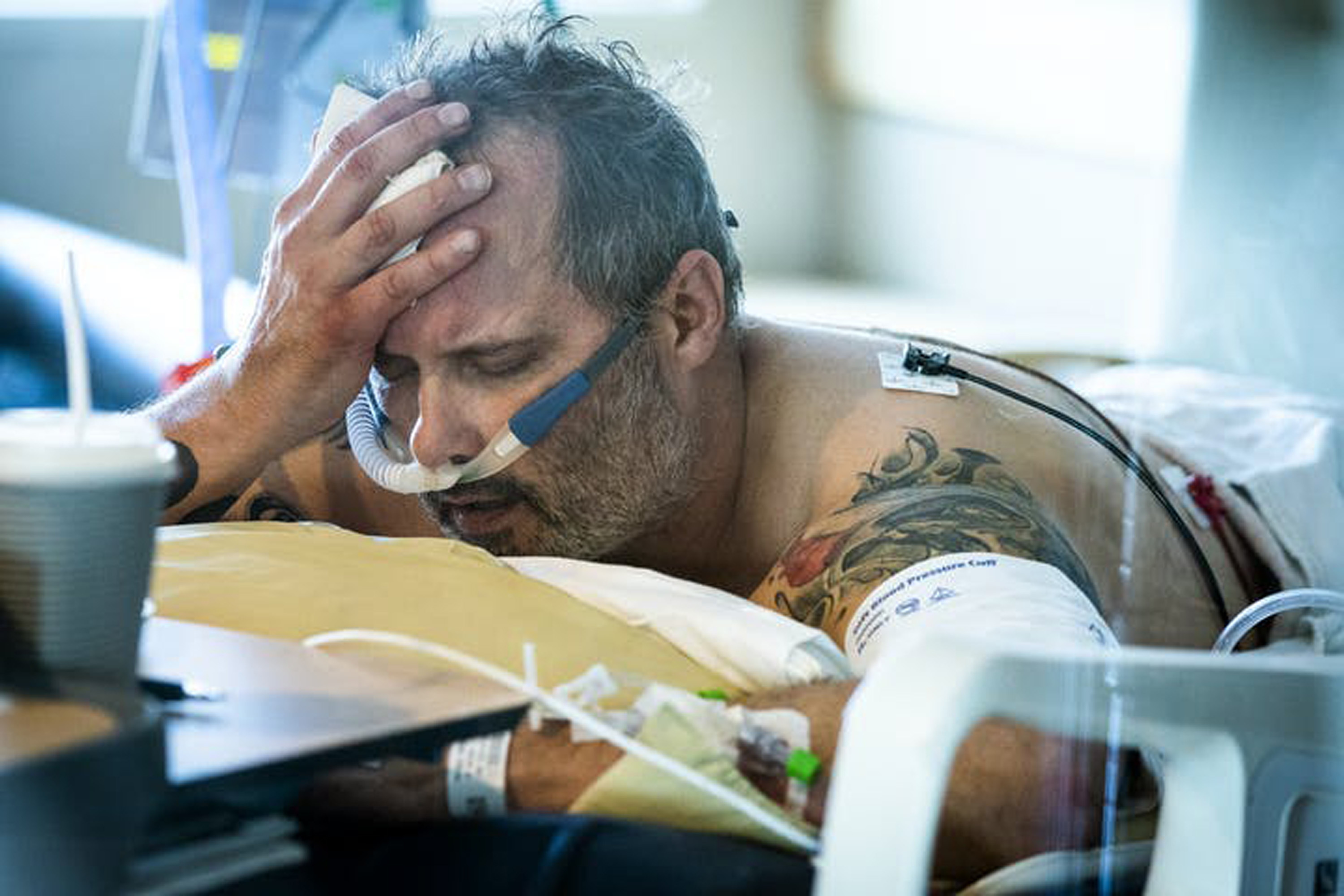 COVID-19 patient Michael Wright lay in his bed in the prone position to increase oxygenation while in the ICU at Regions Hospital in St. Paul.