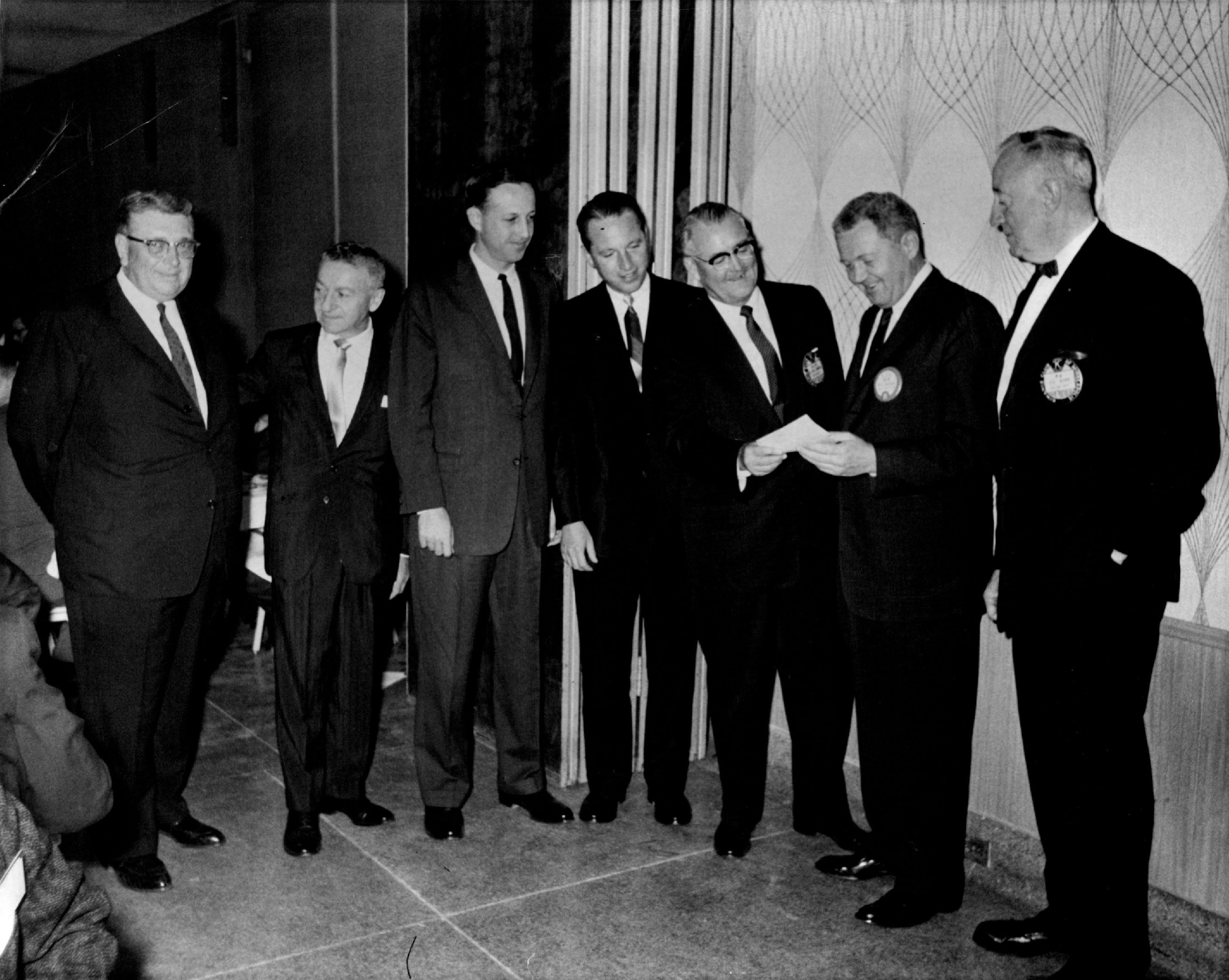 From left, H.P. Skoglund, Max Winter, Pete Rozelle; Bert Rose and Felton Colwell presented Vikings season ticket checks to Bill Boyer, president of the Vikings.