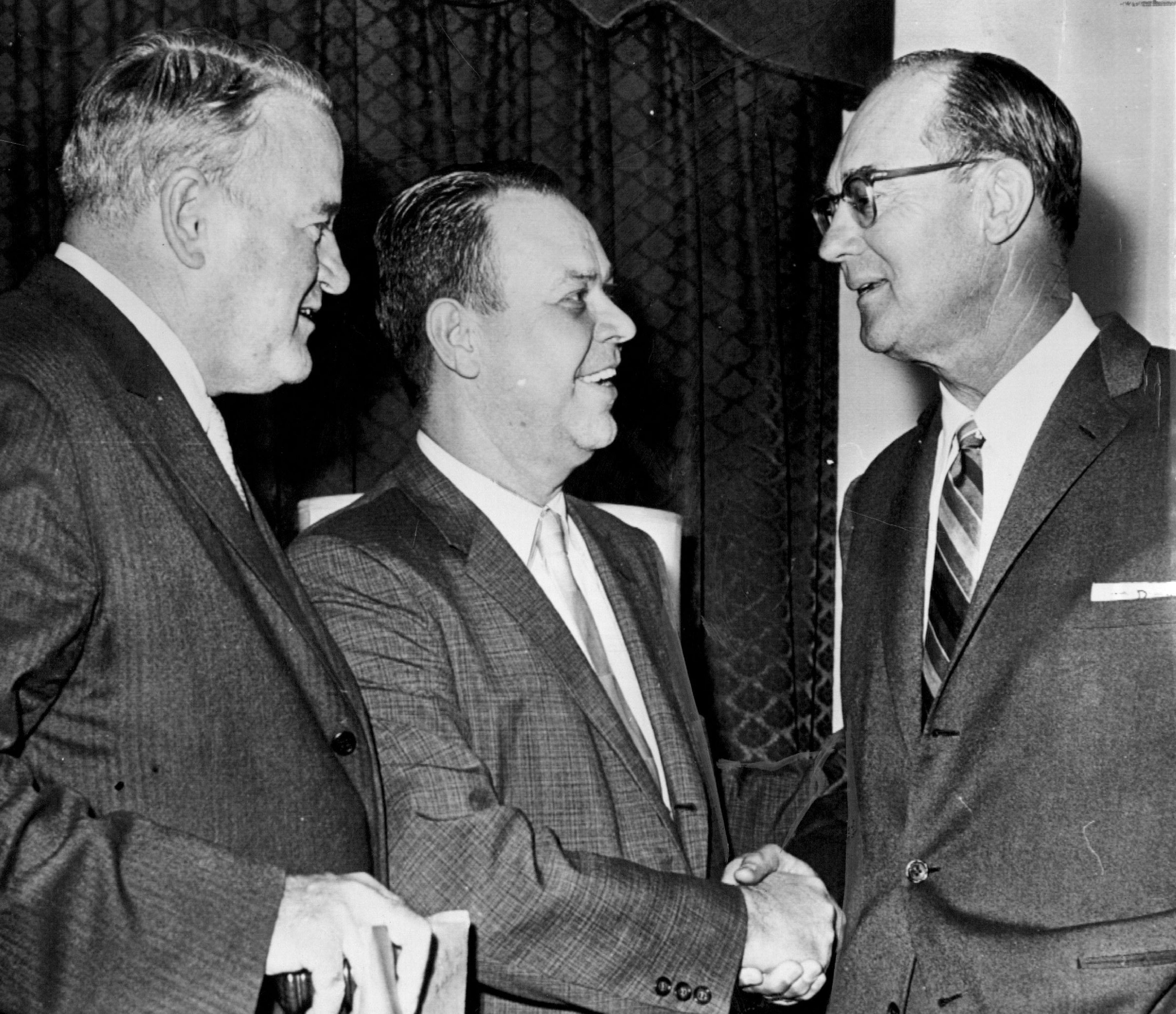 AL President Joe Cronin, left, and Yankees co-owner Del Webb, right, congratulated Calvin Griffith after the announcement that Griffith's Washington Senators were on the move to the Twin Cities.