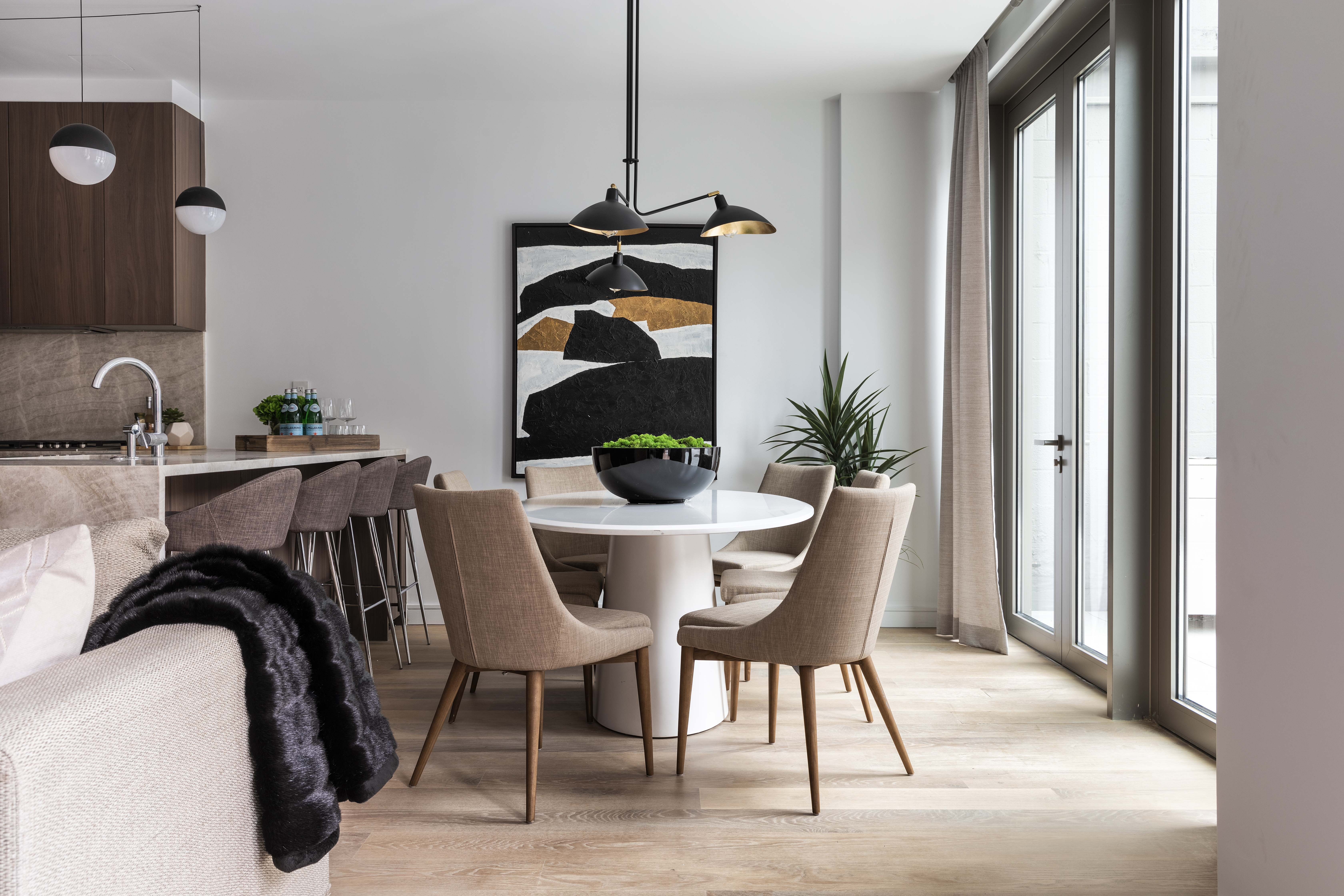 A new ceiling pendant adds a dramatic focal point to this dining space.