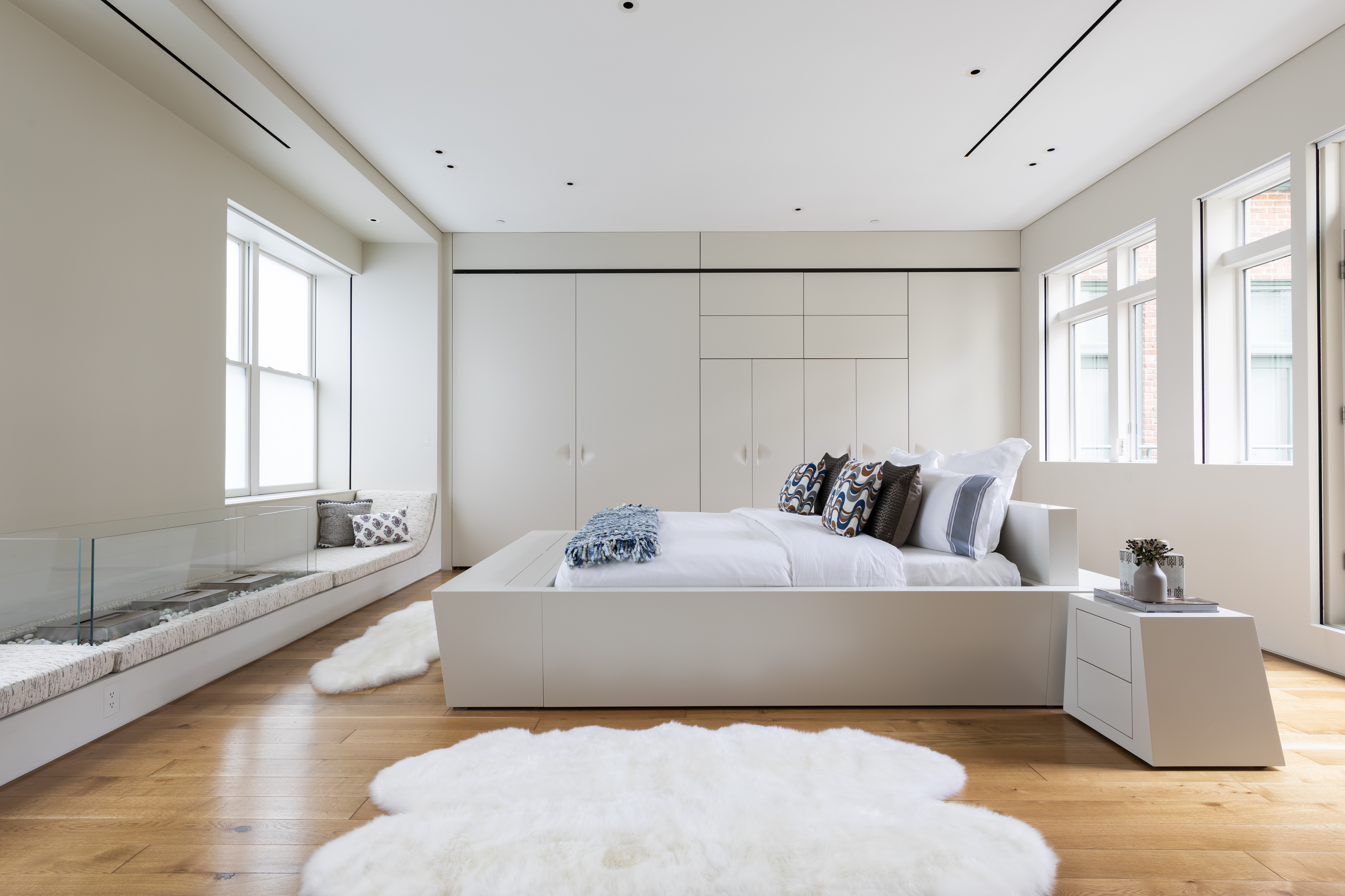 Sheepskin, shag and hide rugs can serve as an alternative to traditional area rugs.