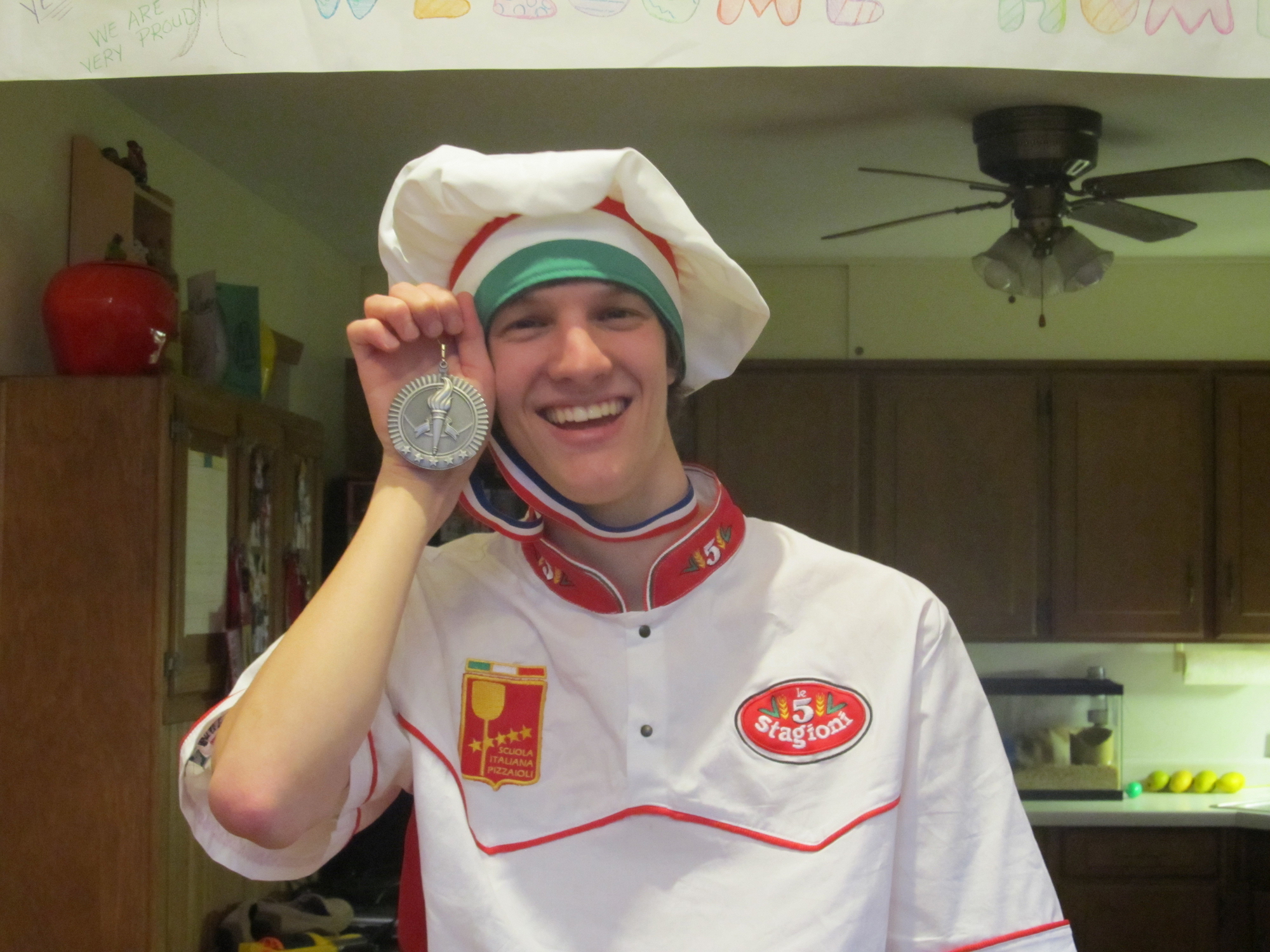 Nick Diesslin with the silver medal he received at the World Pizza Games in 2012.