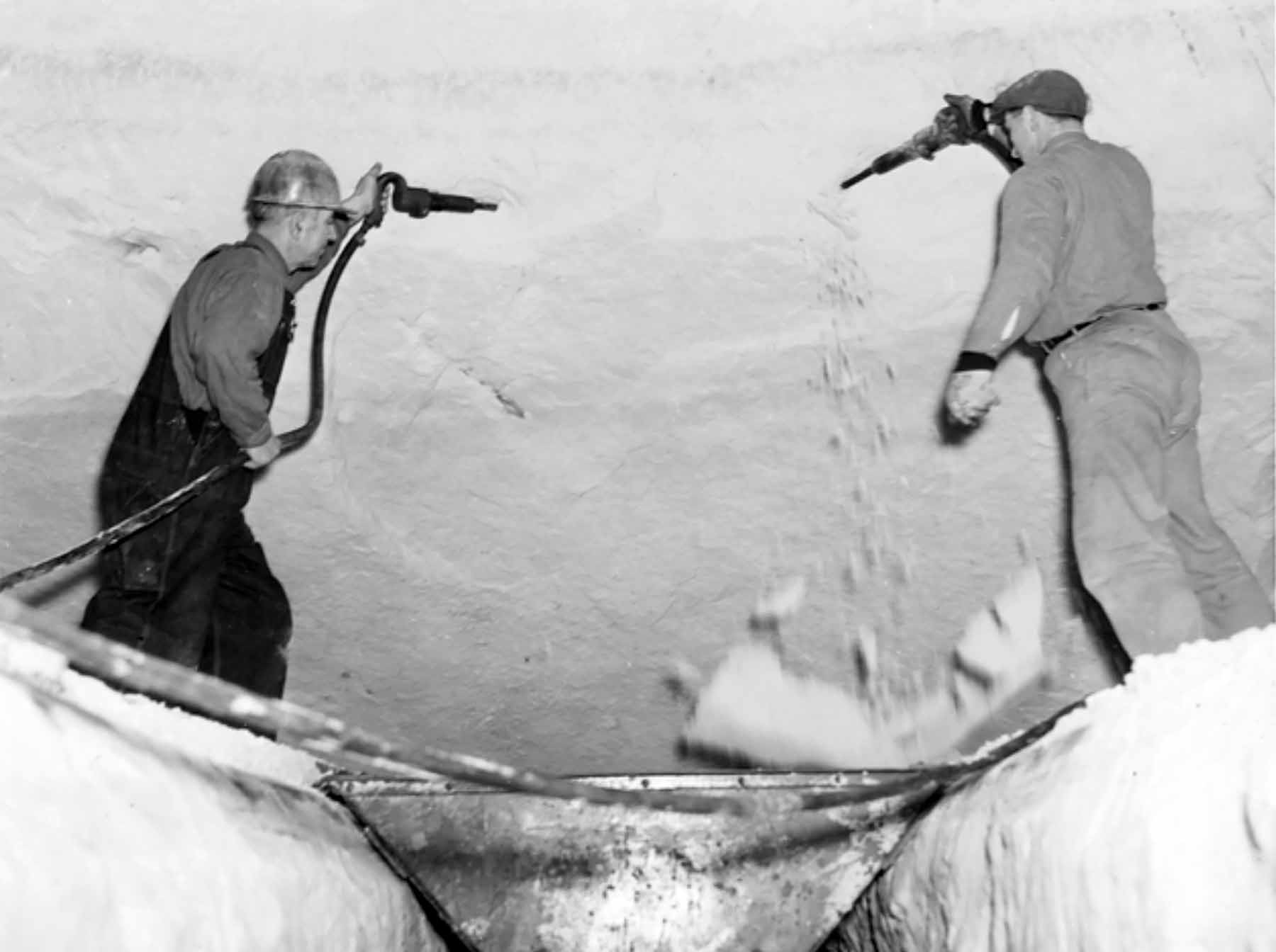 Workers mine silica sand in the tunnels beneath the Ford plant in St. Paul in this 1930s photo.
