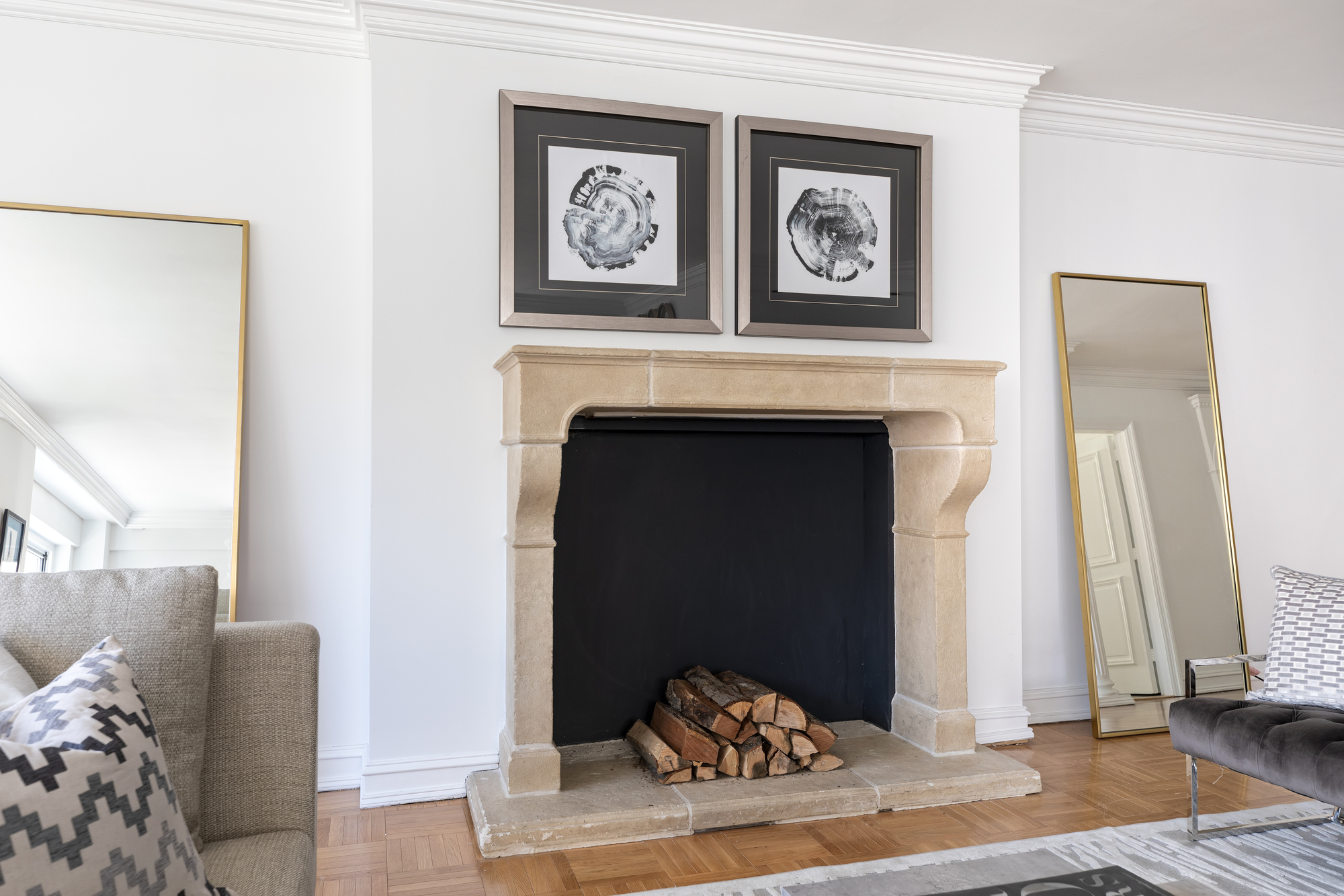 Cozy elements like a wood burning fire or stove help create a sense of holiday charm.