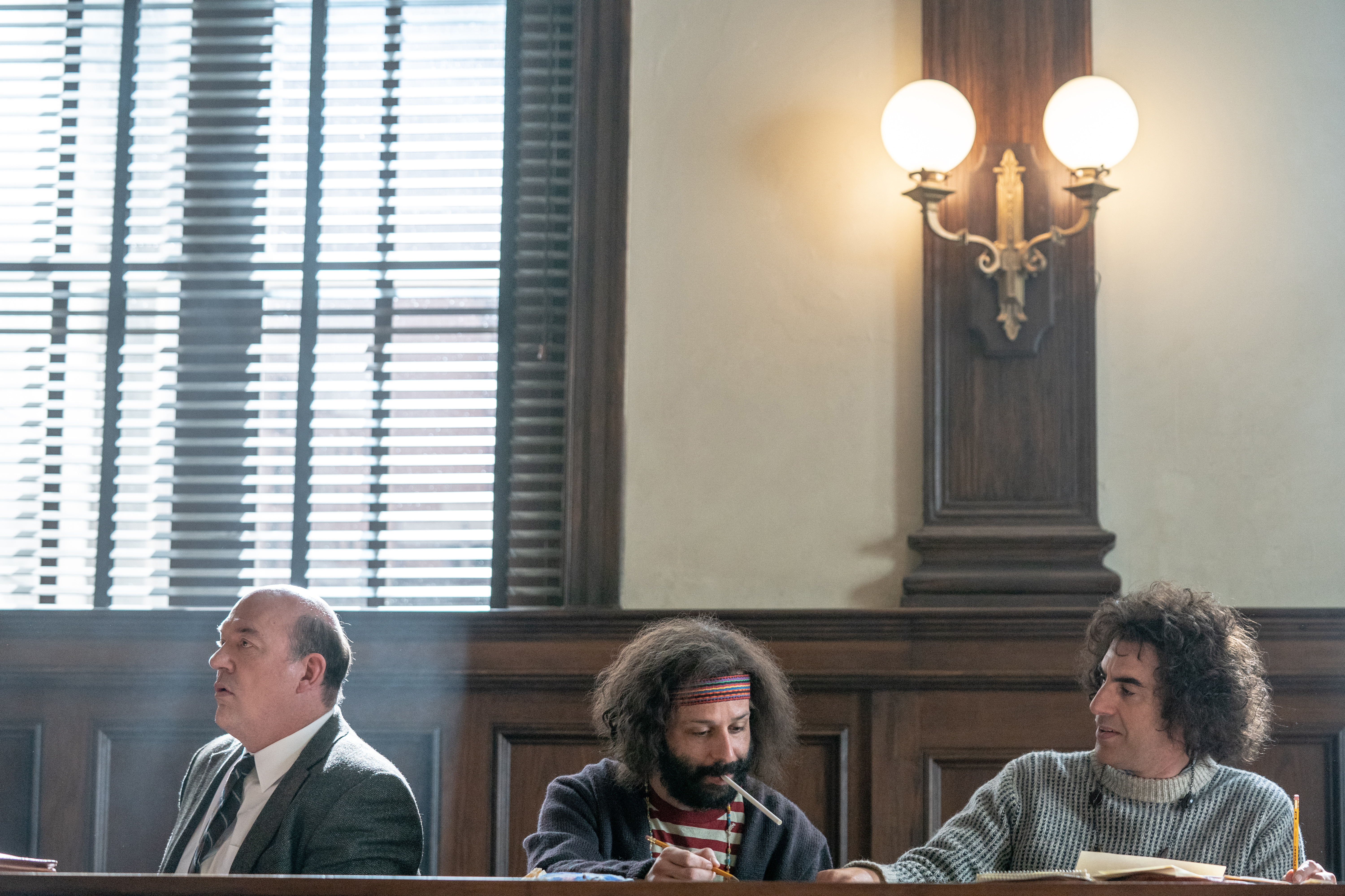 John Carroll Lynch, left, in 'The Trial of the Chicago 7' with Jeremy Strong and Sacha Baron Cohen.