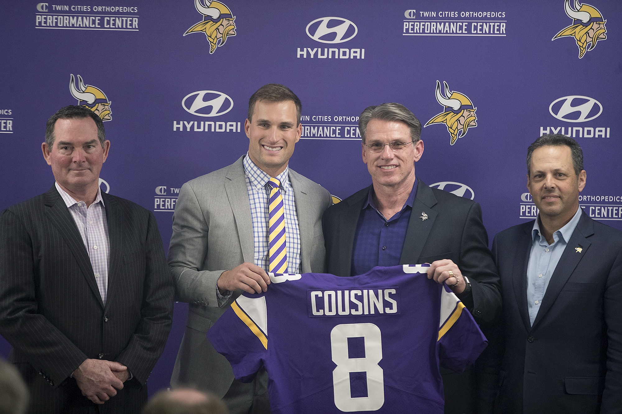 Vikings coach Mike Zimmer, quarterback Kirk Cousins, GM Rick Spielman and co-owner Mark Wilf after Cousins signed with the team in March 2018.