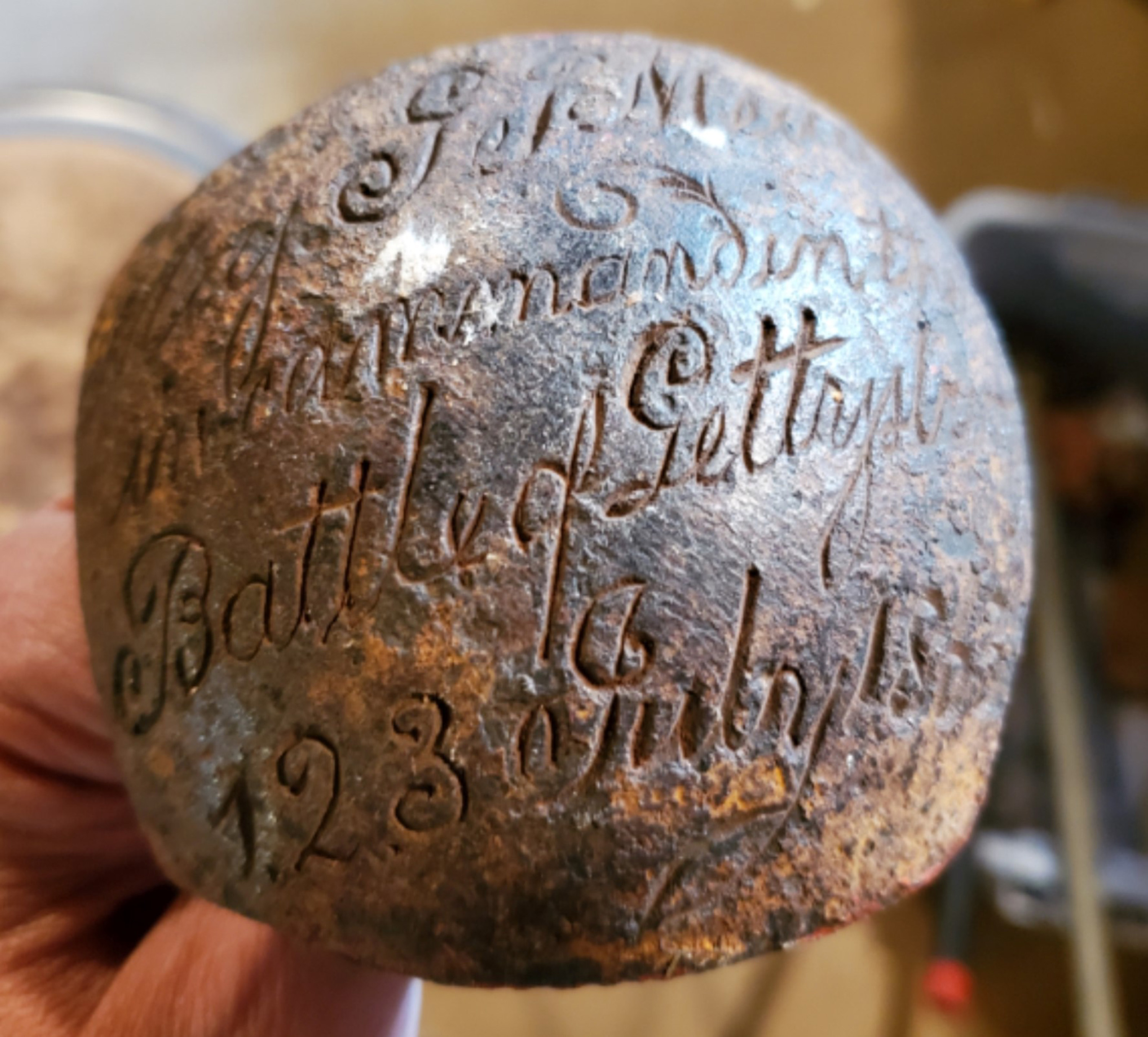 This cannonball is just a fragment, but the engraving is critical to its importance.