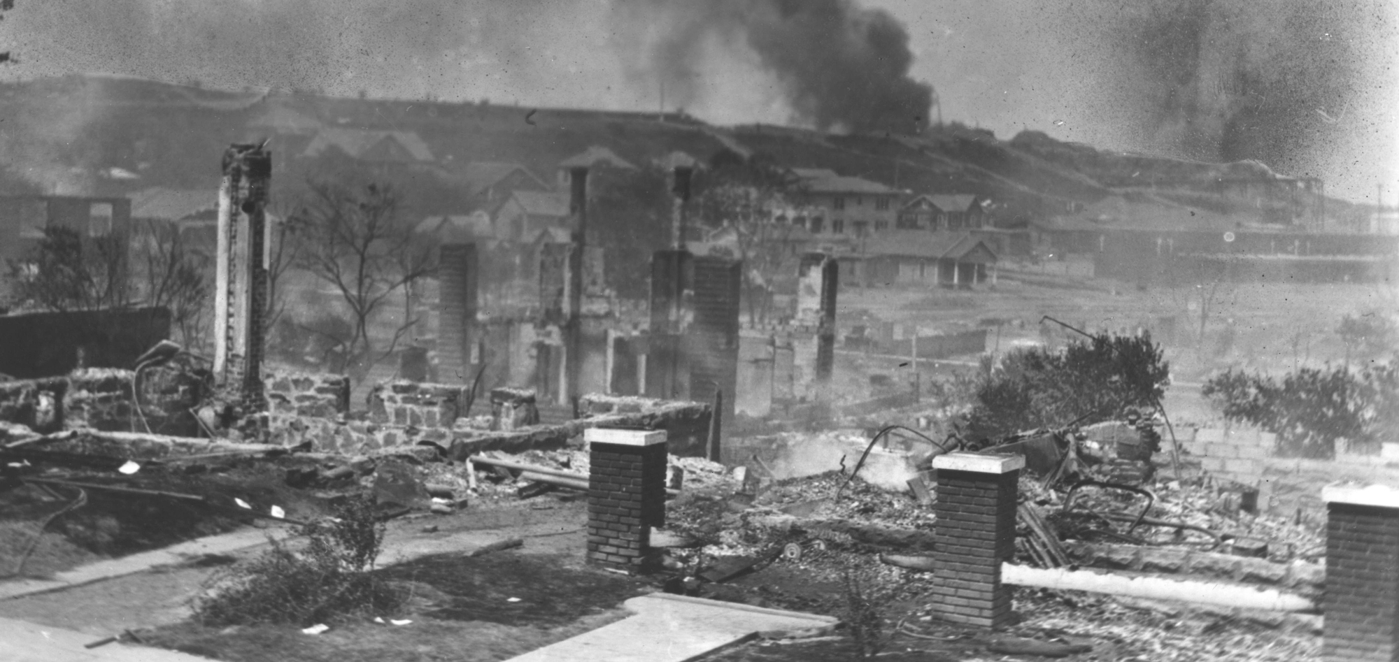 'Goin' Back to T-Town' shows smoldering ruins of homes in Black neighborhood following the racially motivated massacre in Tulsa, Okla., in 1921.